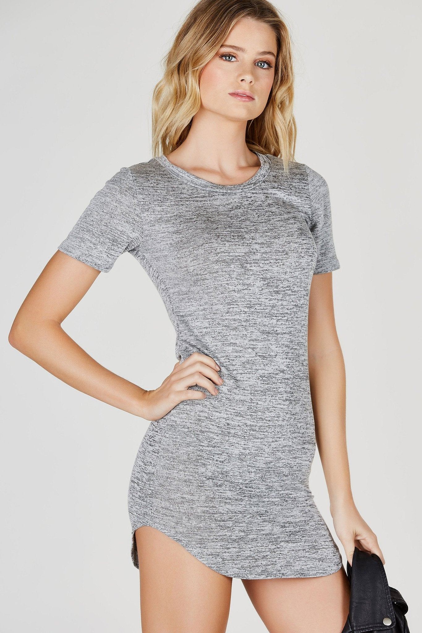 We're taking it back to the basics with this flirty mini dress! Heathered material with short sleeves and rounded hem. Slim fit and lightweight for comfort. Style with a denim jacket and sneakers for an adorable daytime look!