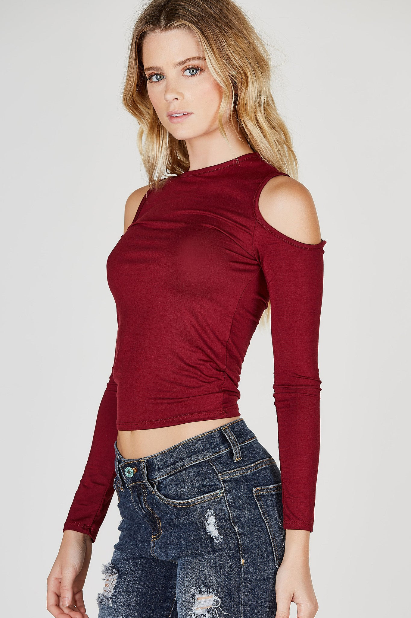 A basic long sleeve top with a fun twist. Chic cold shoulder cut outs for added personality. Soft lightweight material, great to layer under cardigans and jackets. Tuck into high waist skinny jeans and style with ankle boots for a chic transitional outfit.