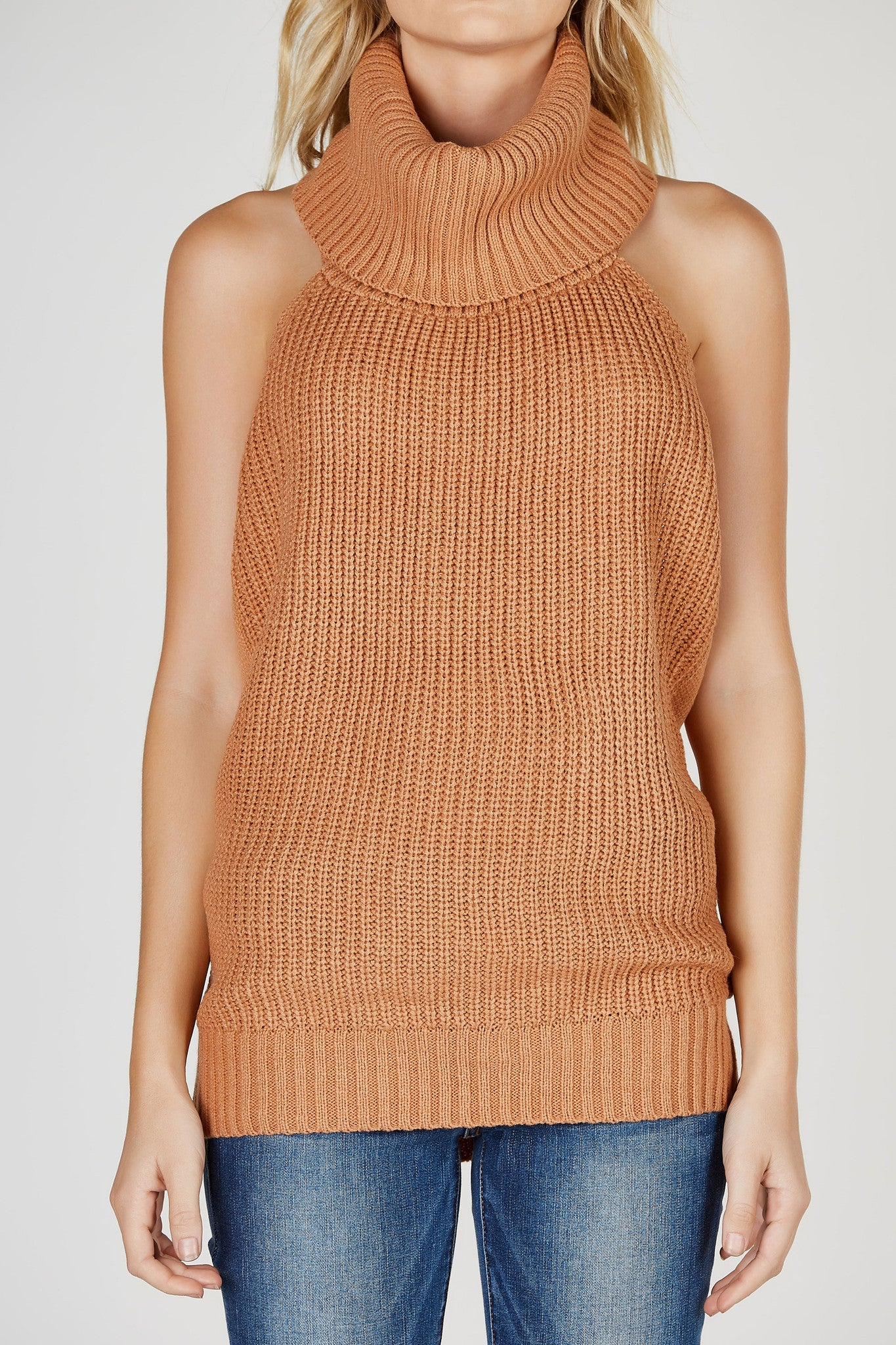 A chic cozy knit sweater top with a slouchy turtleneck. Great to layer under cardigans and jackets or to wear on its own with skinny jeans. Gorgeous open back makes it a perfect transitional piece.