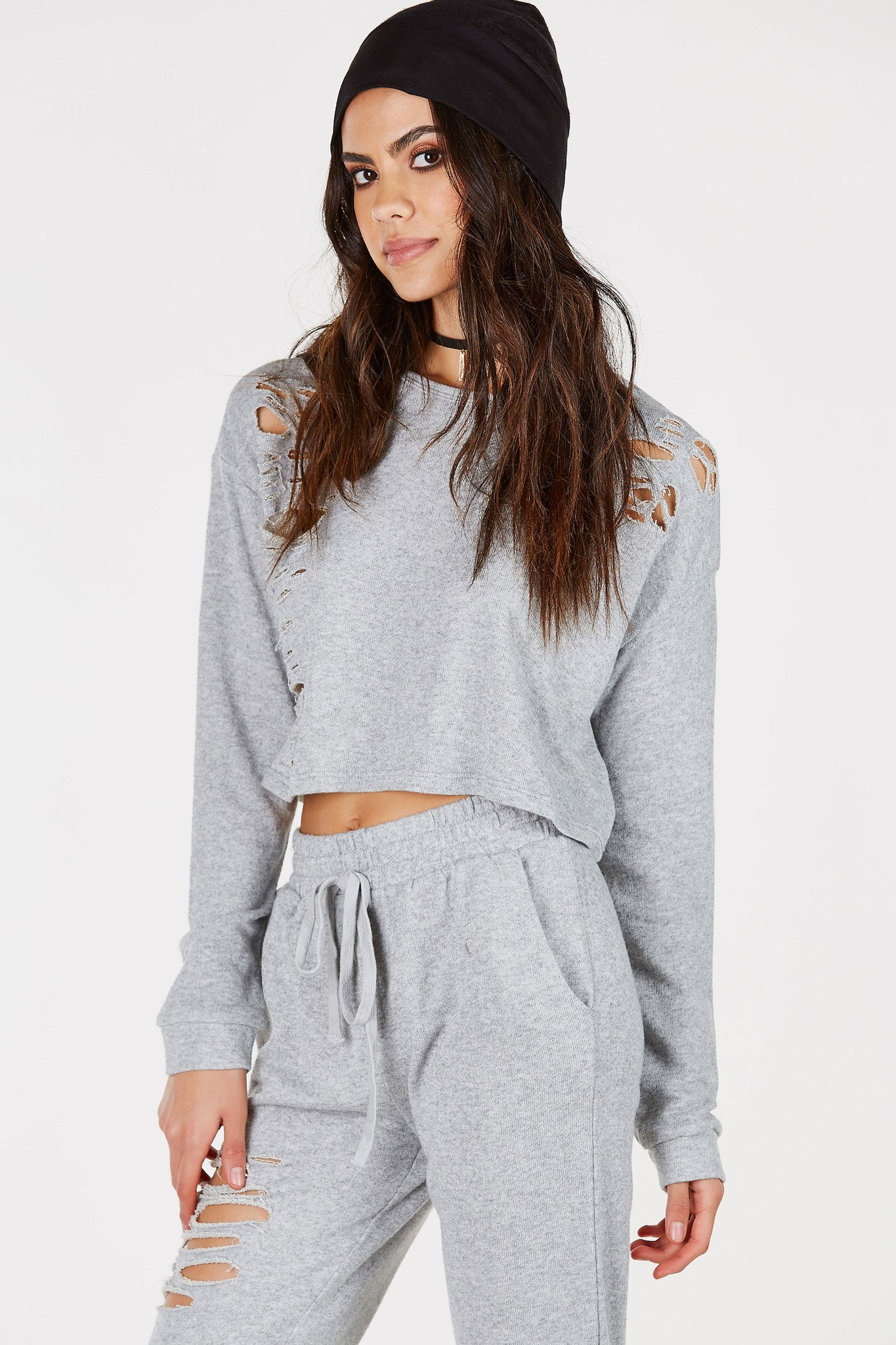 Get on trend with this heavily distressed sweatshirt! Lightweight material makes it perfect for transitioning. Classic crew neckline with a stylish cropped hem. Pair with matching bottoms for an effortless on-the-go outfit!
