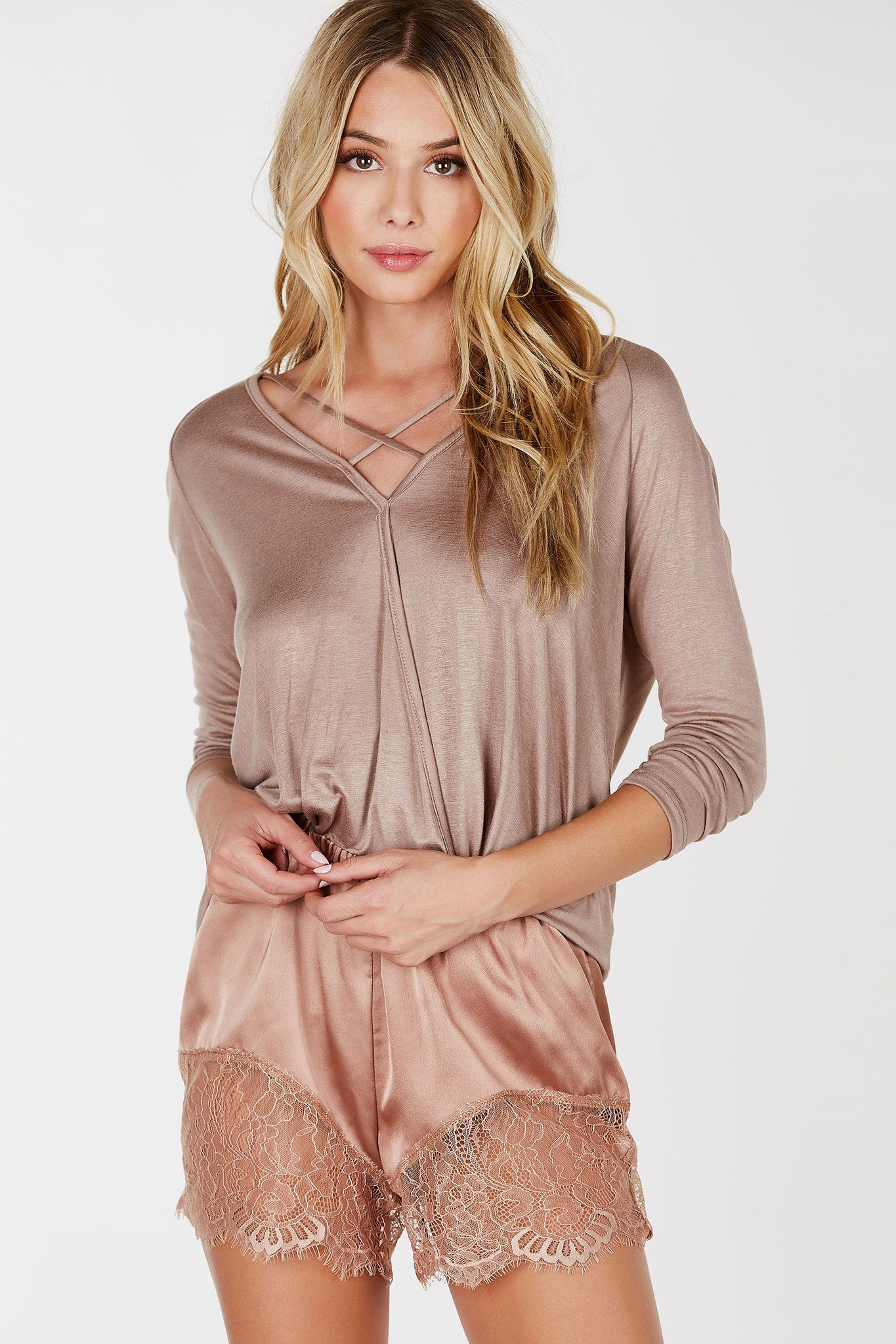 Simple but chic. This soft long sleeve top is definitely a boost from your regular everyday basics! Deep V-neckline with cross over strap detailing with a stylish draped finish. Style with distressed boyfriend jeans and booties!