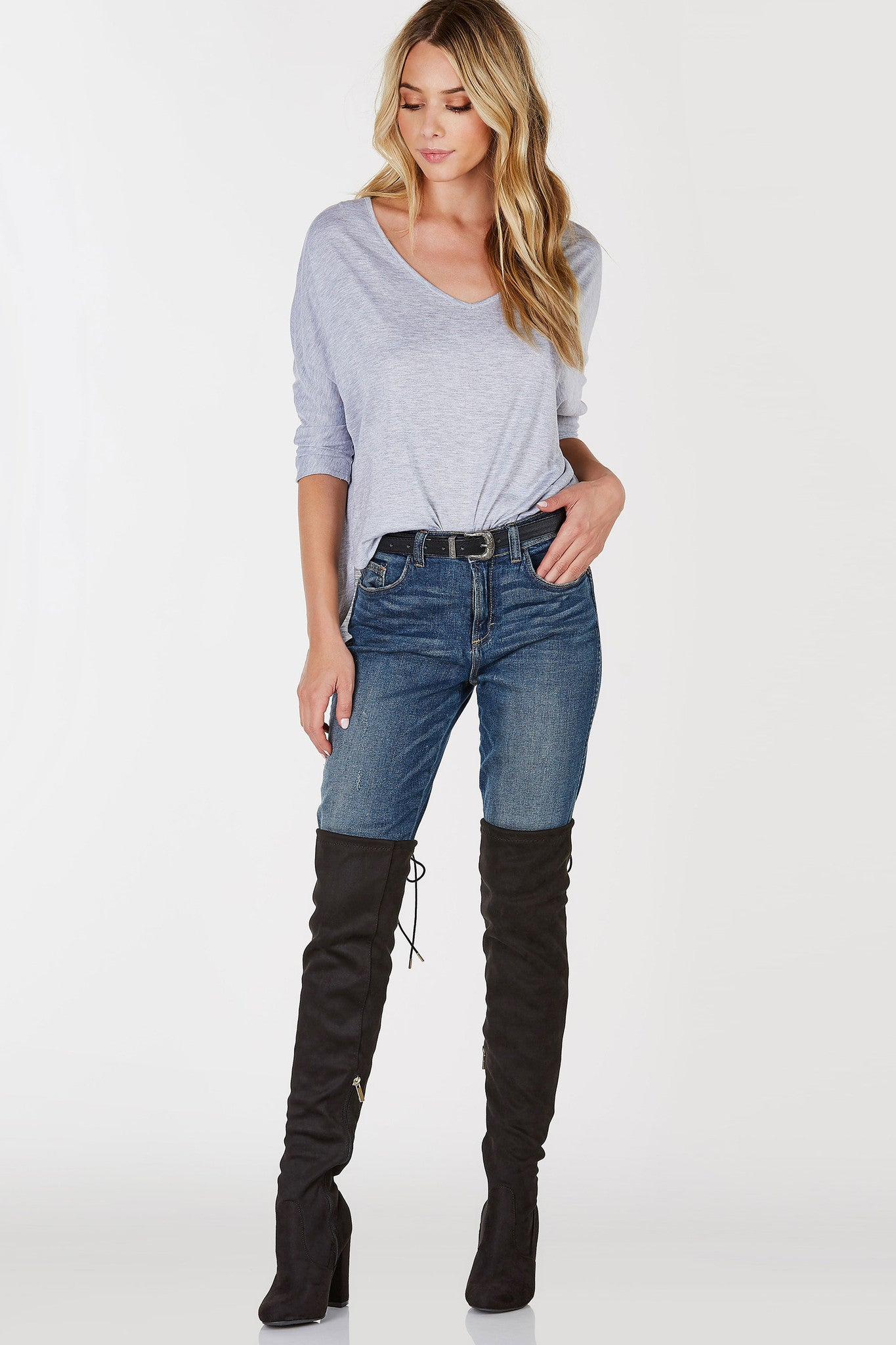 Soft and comfortable, the perfect shirt to wear in and out of bed! Soft V-neckline with cropped dolman sleeves. Rounded hem with a slightly longer back. Throw on a pair of classic skinnies and thigh high boots!