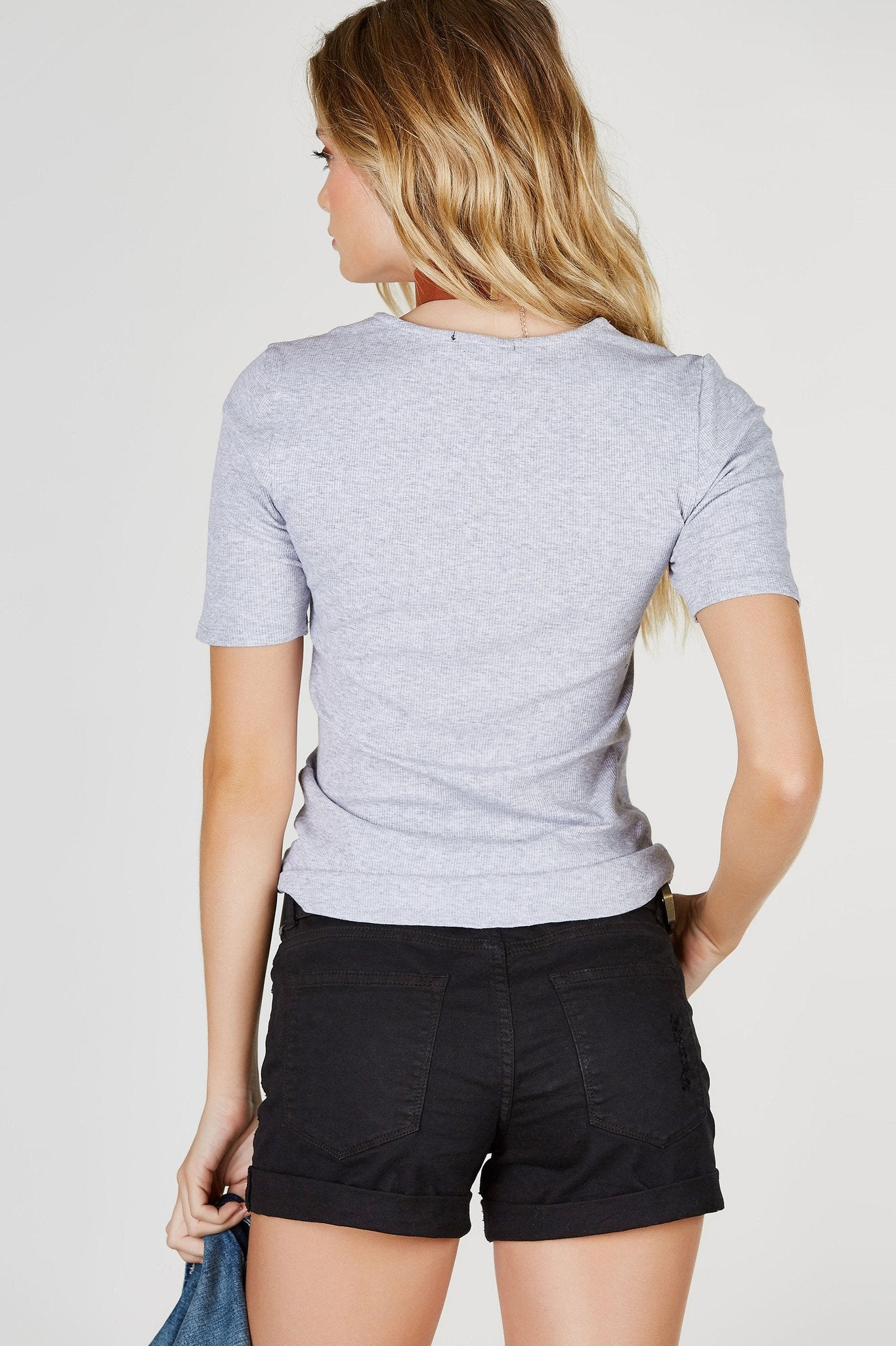 A classic ribbed short sleeve tee with a trendy lace up neckline. Lightweight and stretchy, great for all day wear. Tuck into high waist skinnies for a daytime look or pair with a midi skirt for a chic evening look!