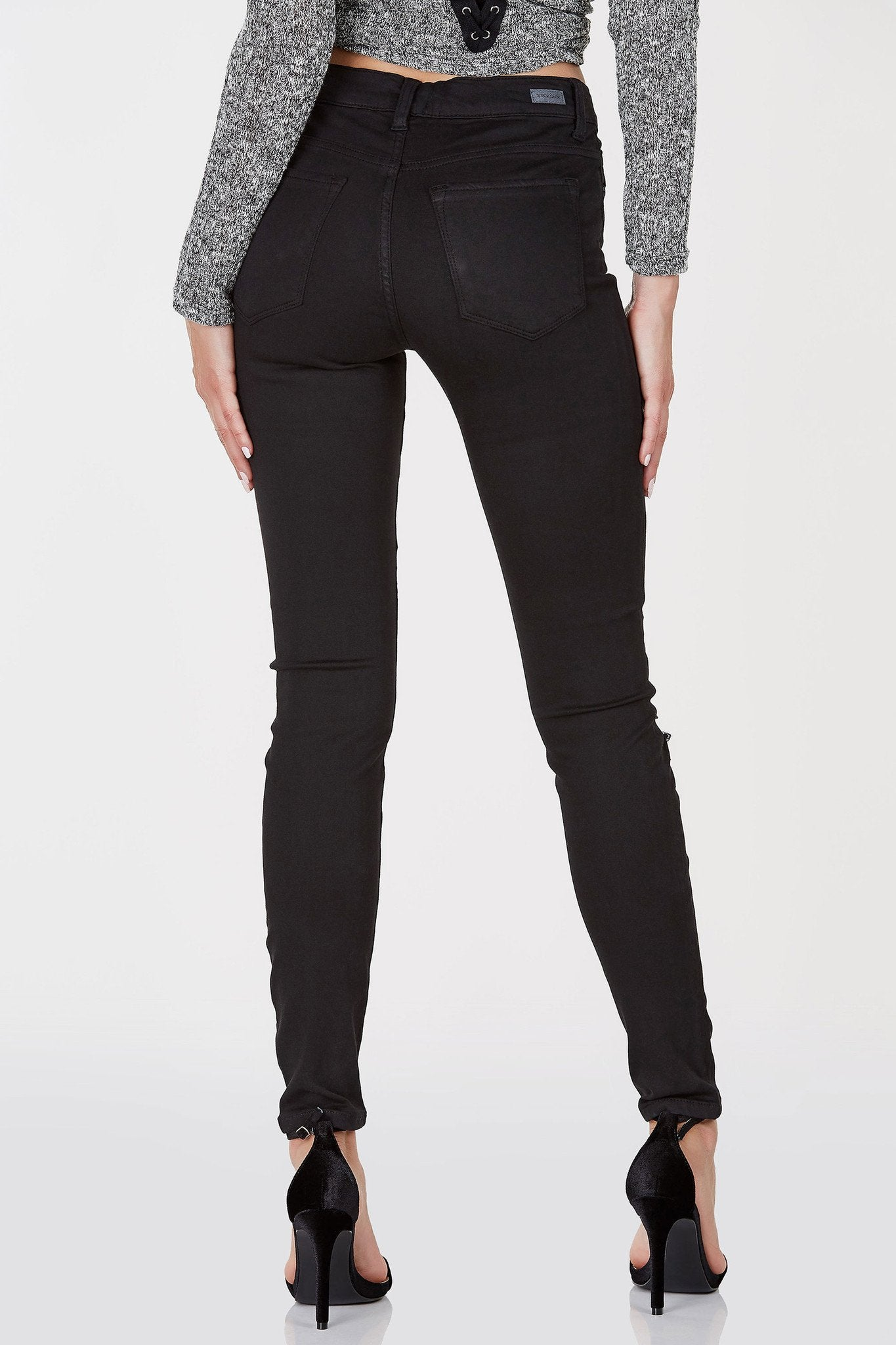 A classic pair of skinny jeans with trendy rips throughout the front. Stretchy material with a comfortable, slim fit. Mid rise waist makes it versatile to style with just about any style of top!