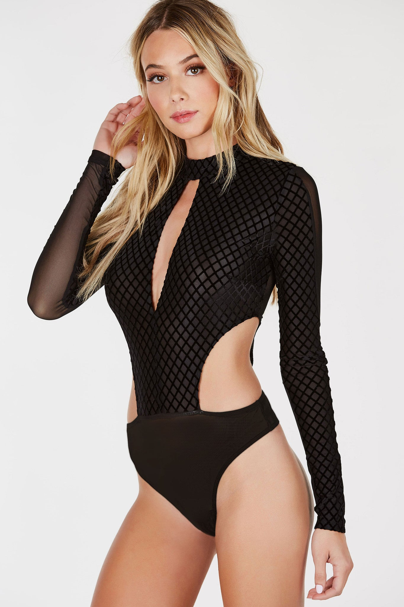 A stunning bodysuit with a gorgeous contrast design. Mesh base all around with chic velvet patterns in front. Mock neck with a daring keyhole cut out in front and side. Cheeky cut with snap on button closure for easy, seamless wear.