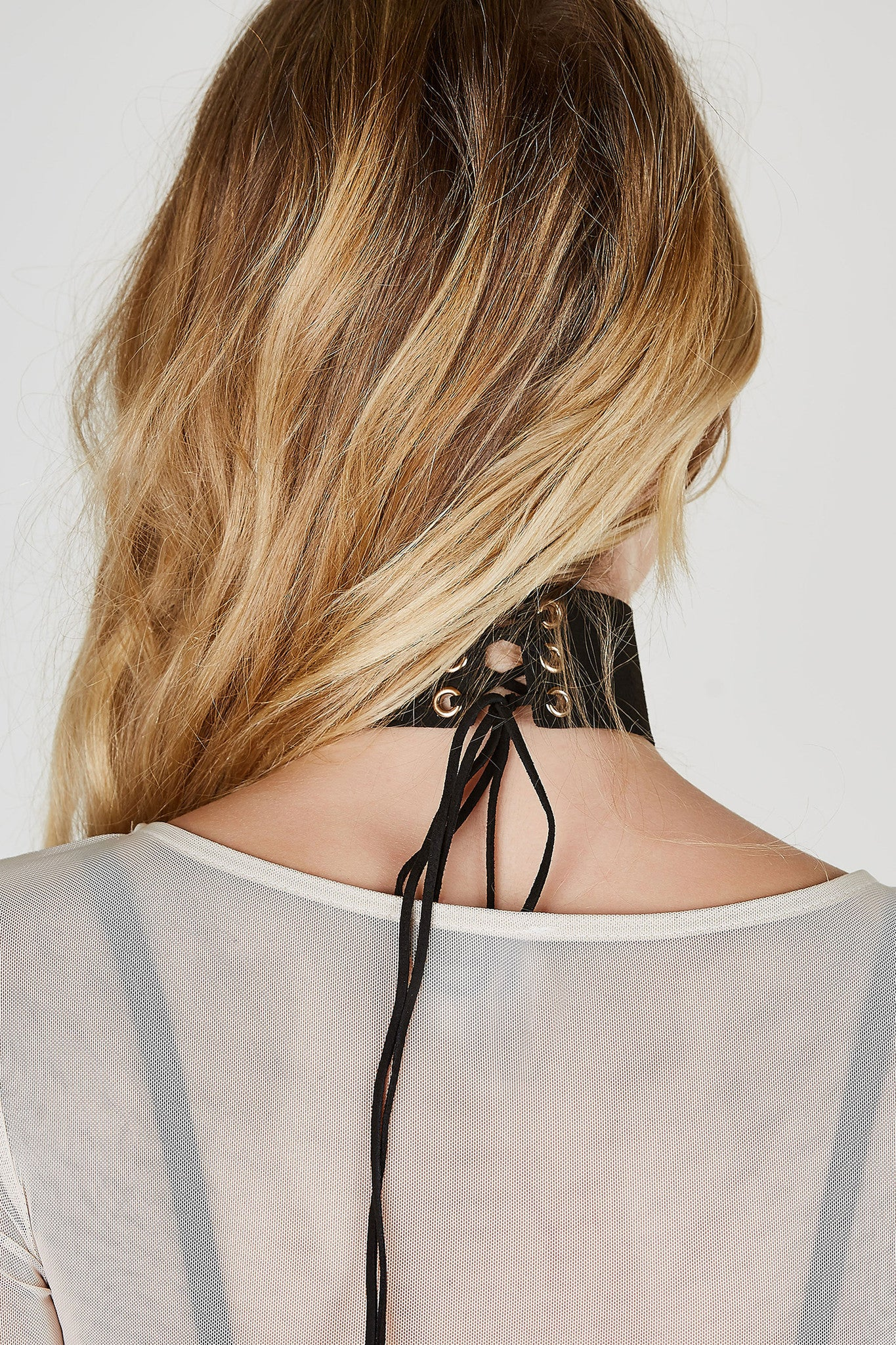 Take your basic outfit to the next level by adding this awesome choker to your look! Wide band design detailing a trendy lace up closure at center for fit and closure.