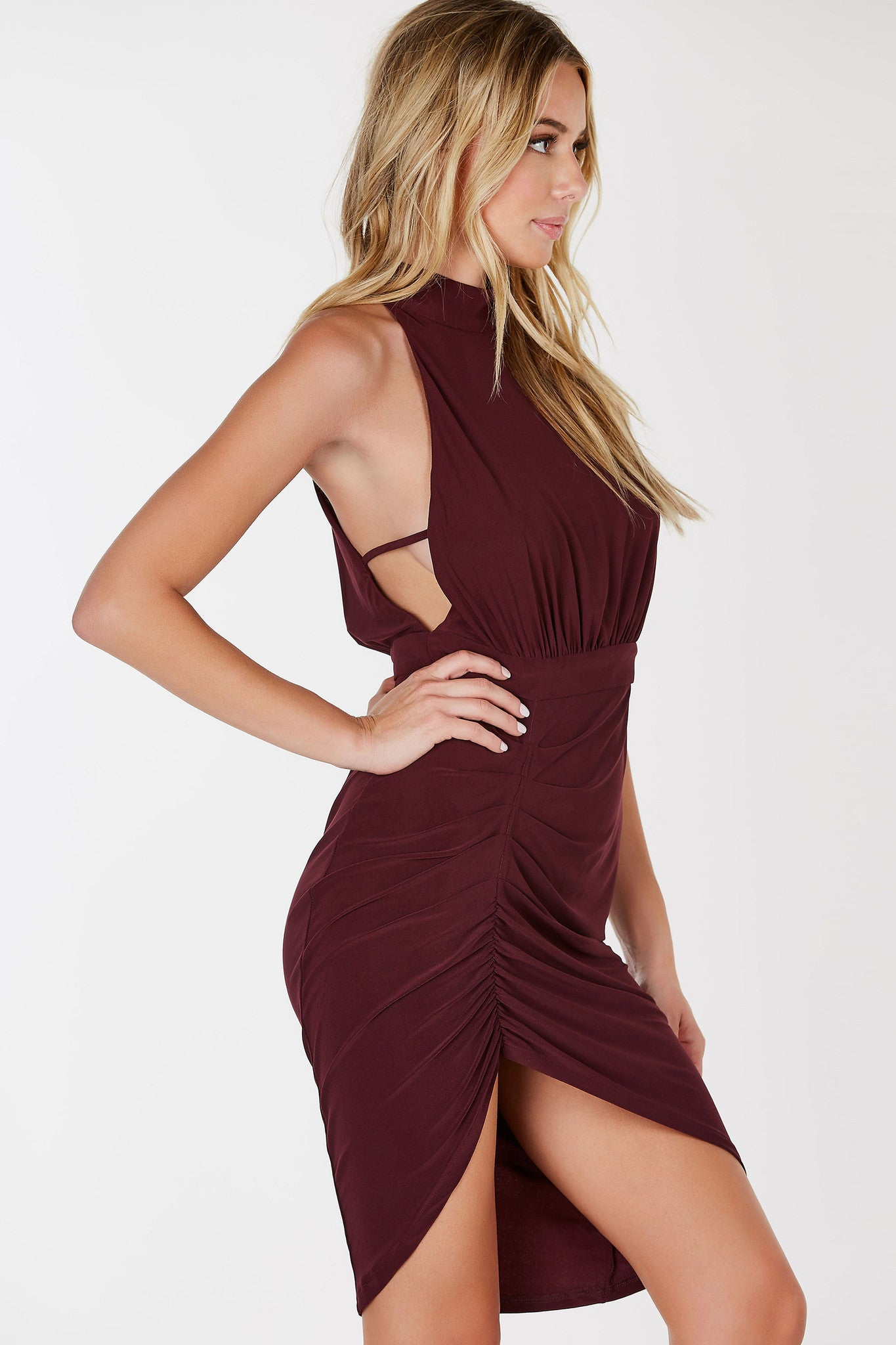 A gorgeous midi dress with chic ruching throughout the front. Flattering halter mock-neckline with deep cut sides for a sexy vibe. Sharkbite hem with a body hugging fit to bring out your curves. Slinky material all around for amazing stretch and comfort.