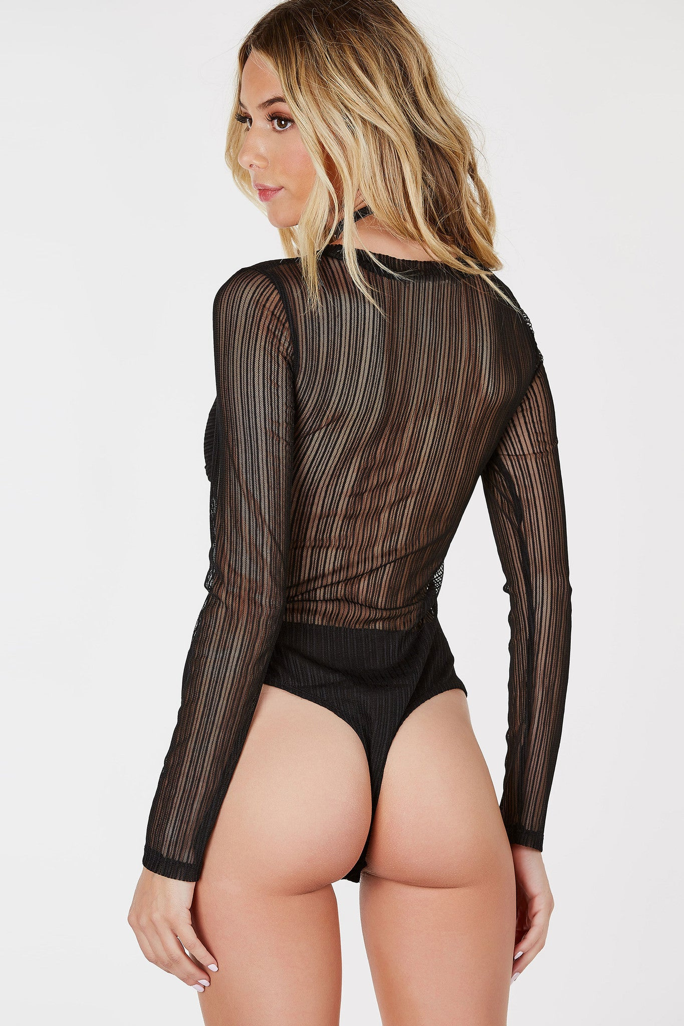 Make a sexy bold statement with this ultra chic mesh bodysuit! Contrast stripe detailing throughout with a flirty knotted layer at bust. Flattering slim fit with a cheeky cut and snap on buttons for closure.