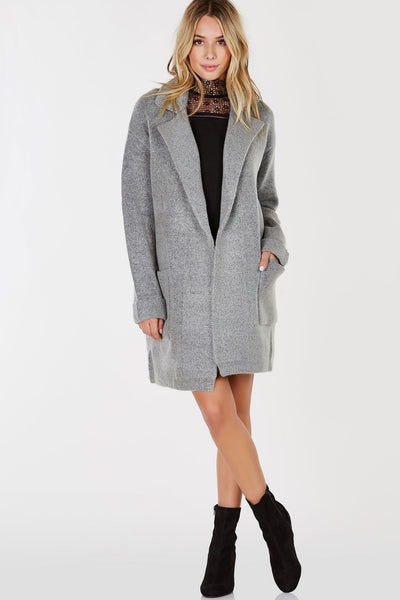 A incredibly chic but comfy cardigan with a blazer vibe. Soft blend of materials with a long line fit. Open front with classic blazer style collar. Style with a long sleeve top and skinny jeans with tall boots!