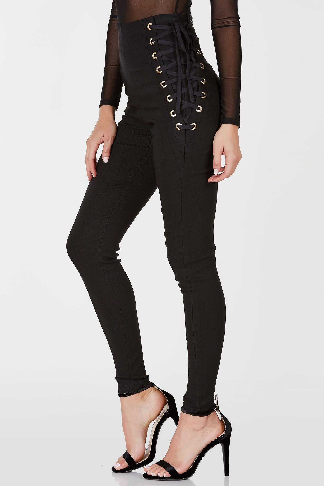 Take your dressy pants to the next level with these awesome lace up pants! Chic eyelet detailing with laces for adjustable fit and style. Super stretchy material provides a comfortable, flattering fit. Exposed zipper in back for closure. Style with a bodysuit and pumps for an evening look.