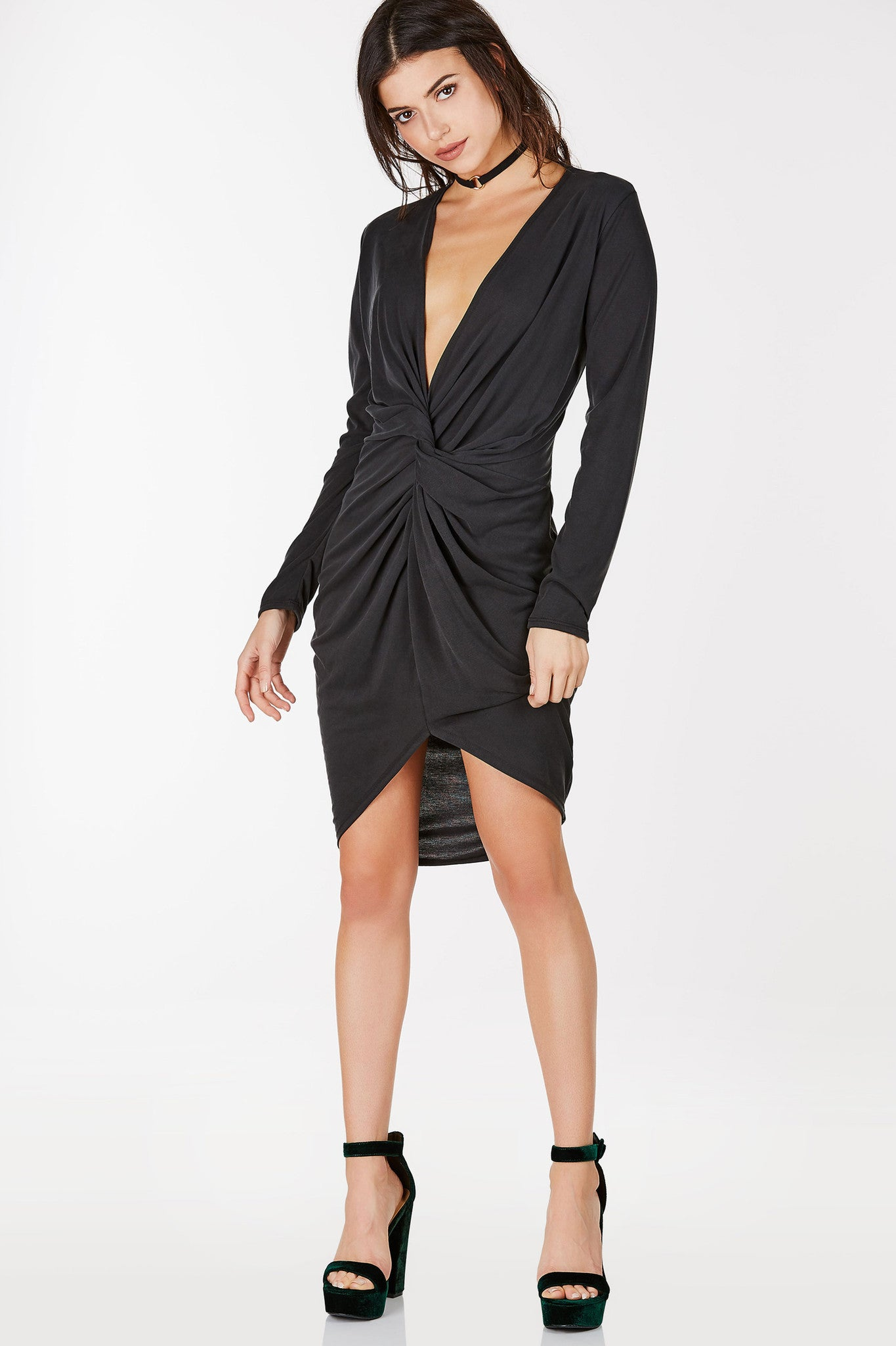 Long sleeve midi dress with plunging neckline. Twist detailing at center with hi-low shark bite style hem.