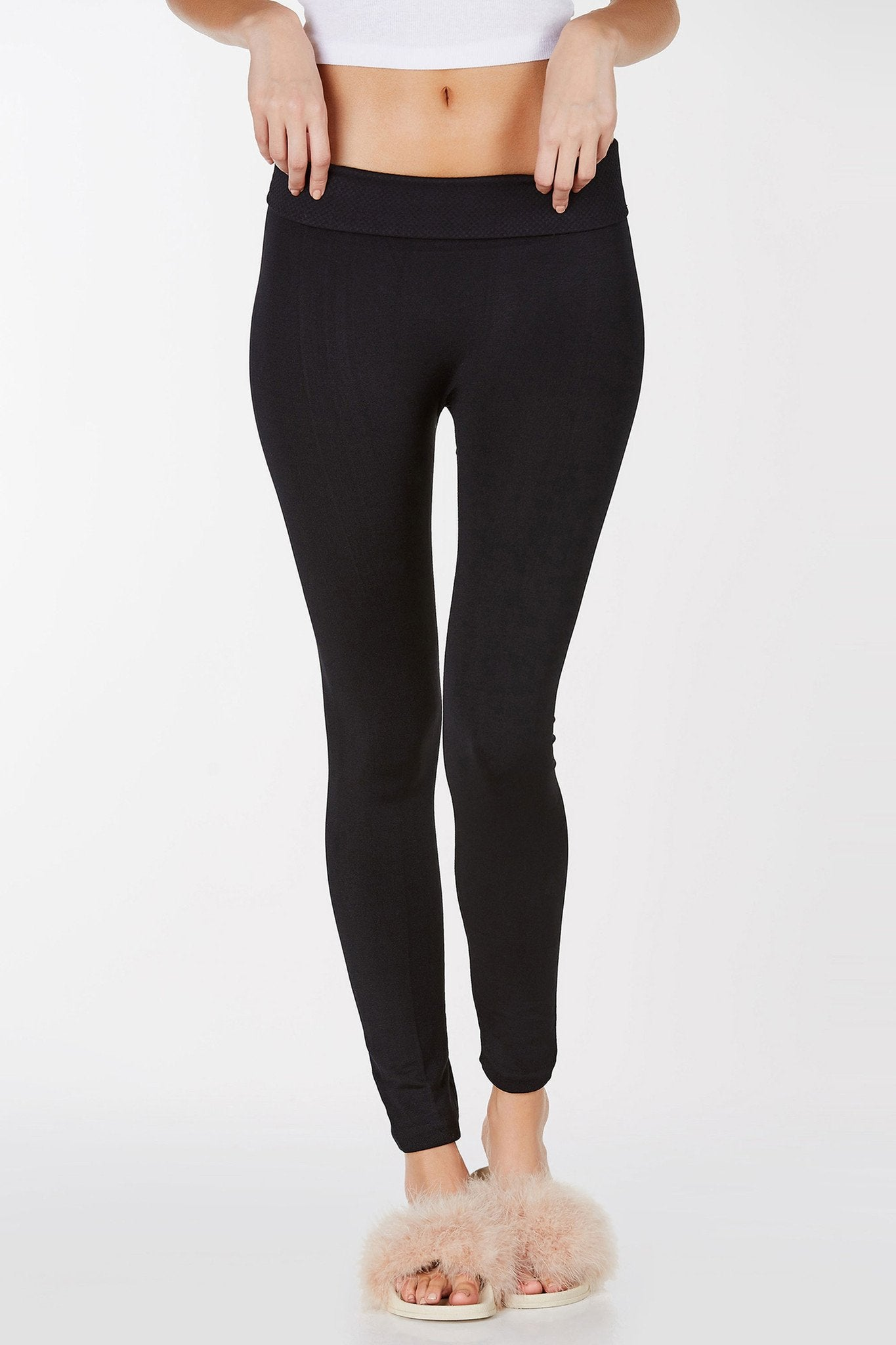 High rise leggings with fold over waistband. Stretchy material with slim fit.