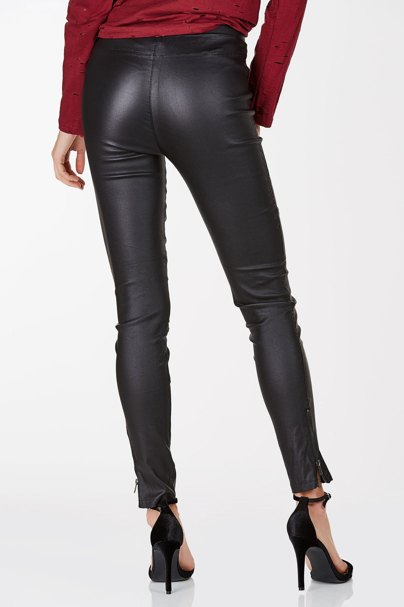 High waisted pants with faux leather finish. Zip detailing at hem with stretchy slim fit.