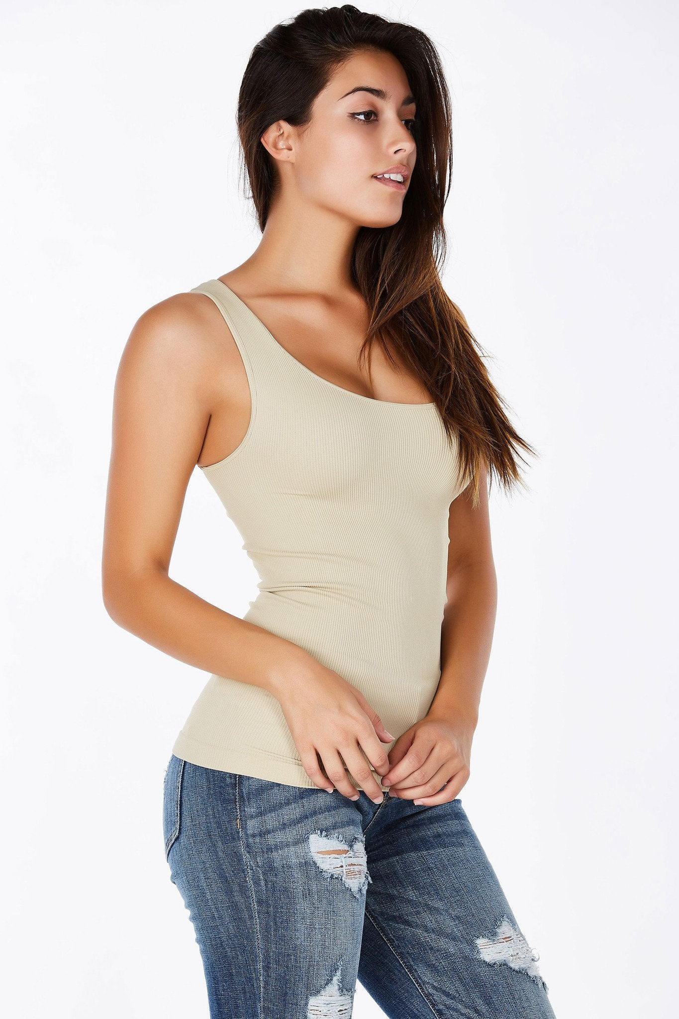The perfect ribbed basic tank top! This top has ribbed fabric throughout with a tight fit. Has a good spandex content to it, one size fits all.