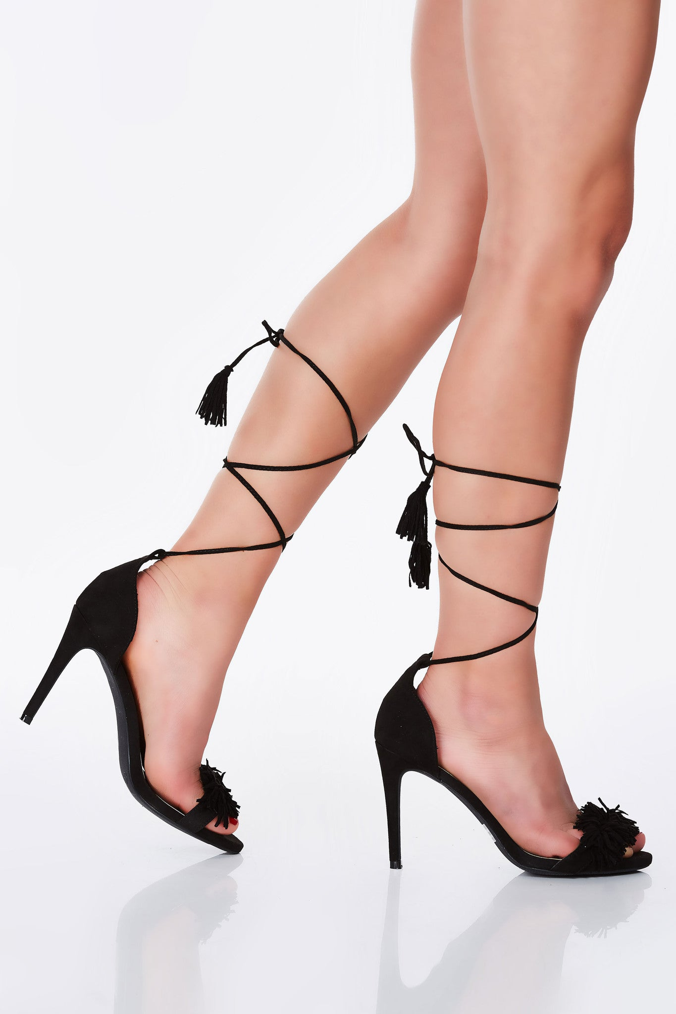 An incredible pair of pumps with a sleek, trendy design. Amazing faux suede exterior with chic tassel and fringe detailing. Sexy lace up finish, perfect for a hot date night!