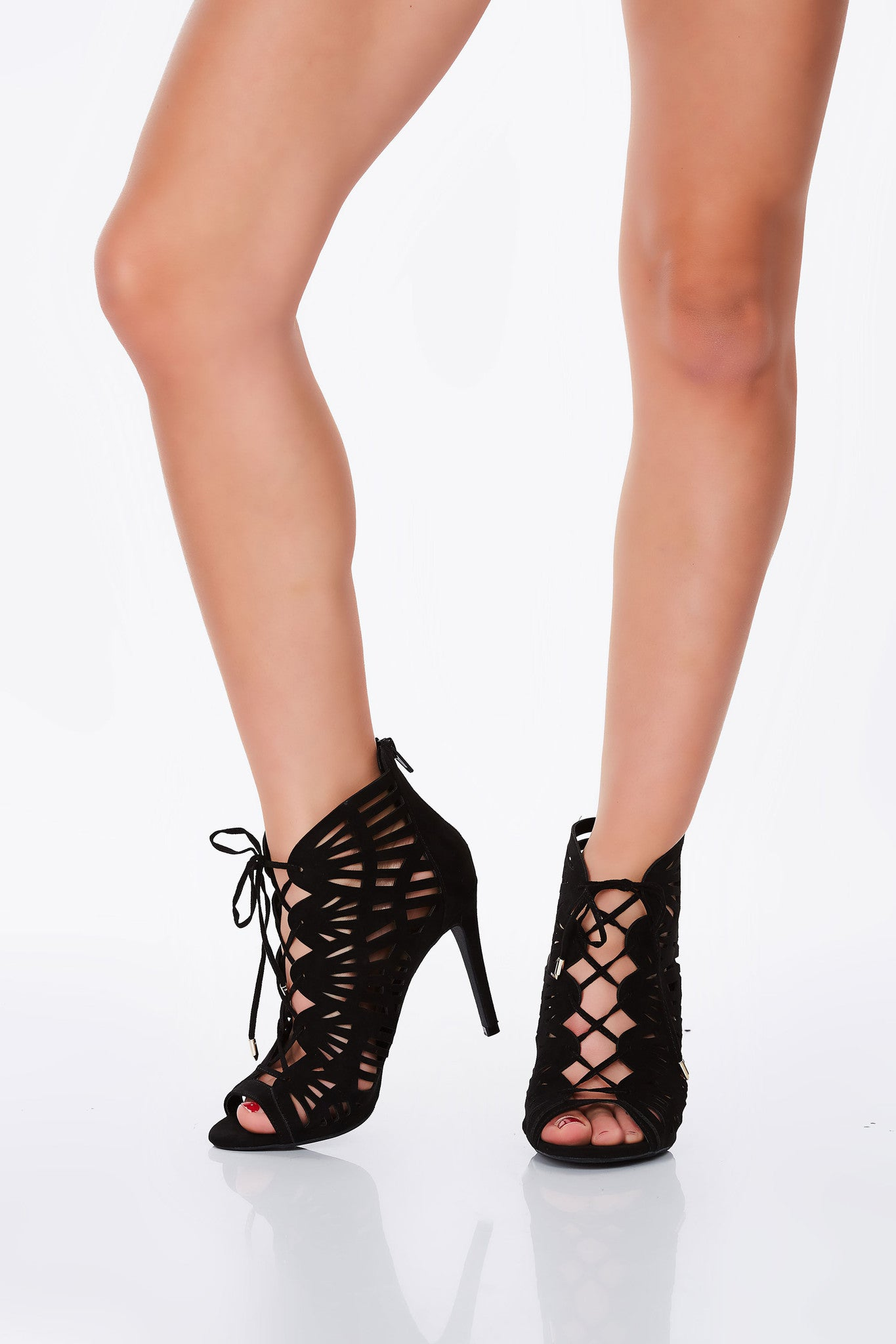 A glam pair of pumps with gorgeous laser cut detailing. Sensual lace up design with a chic peep-toe finish. Single zipper in back for easy wear.
