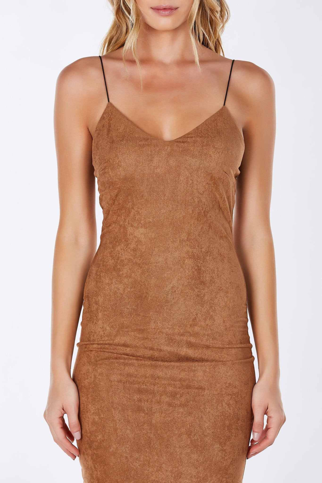 Made from a soft, faux seude and fully lined. Lingerie styled slip dress with a slinky fit. Subtle V-neckline with elastic straps.