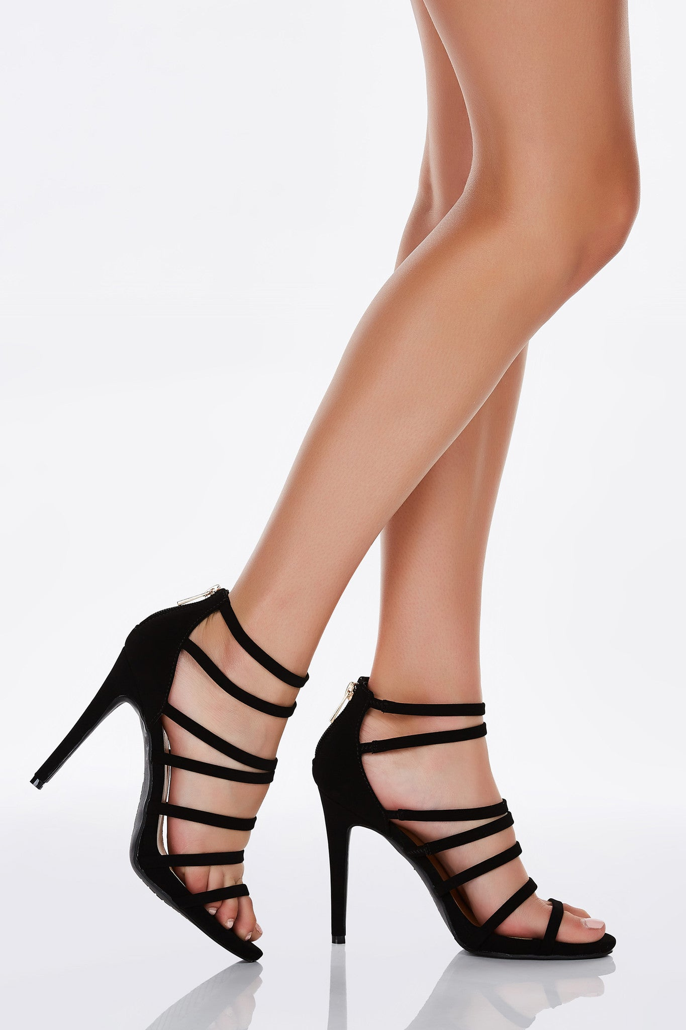 A stunning pair of heels with sexy multi strap detailing. Smooth, chic exterior with a single zip back closure. Tiny elastic bands by ankle for comfortable steppin'!