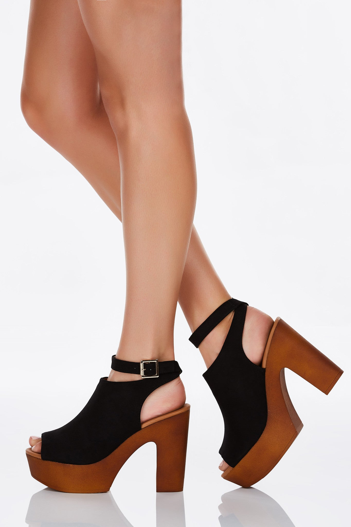 A chic pair of chunky heels with awesome platforms for comfy walking! Add some extra height effortlessly and in style. Wrap around ankle strap with a single buckle adjustable for fit.