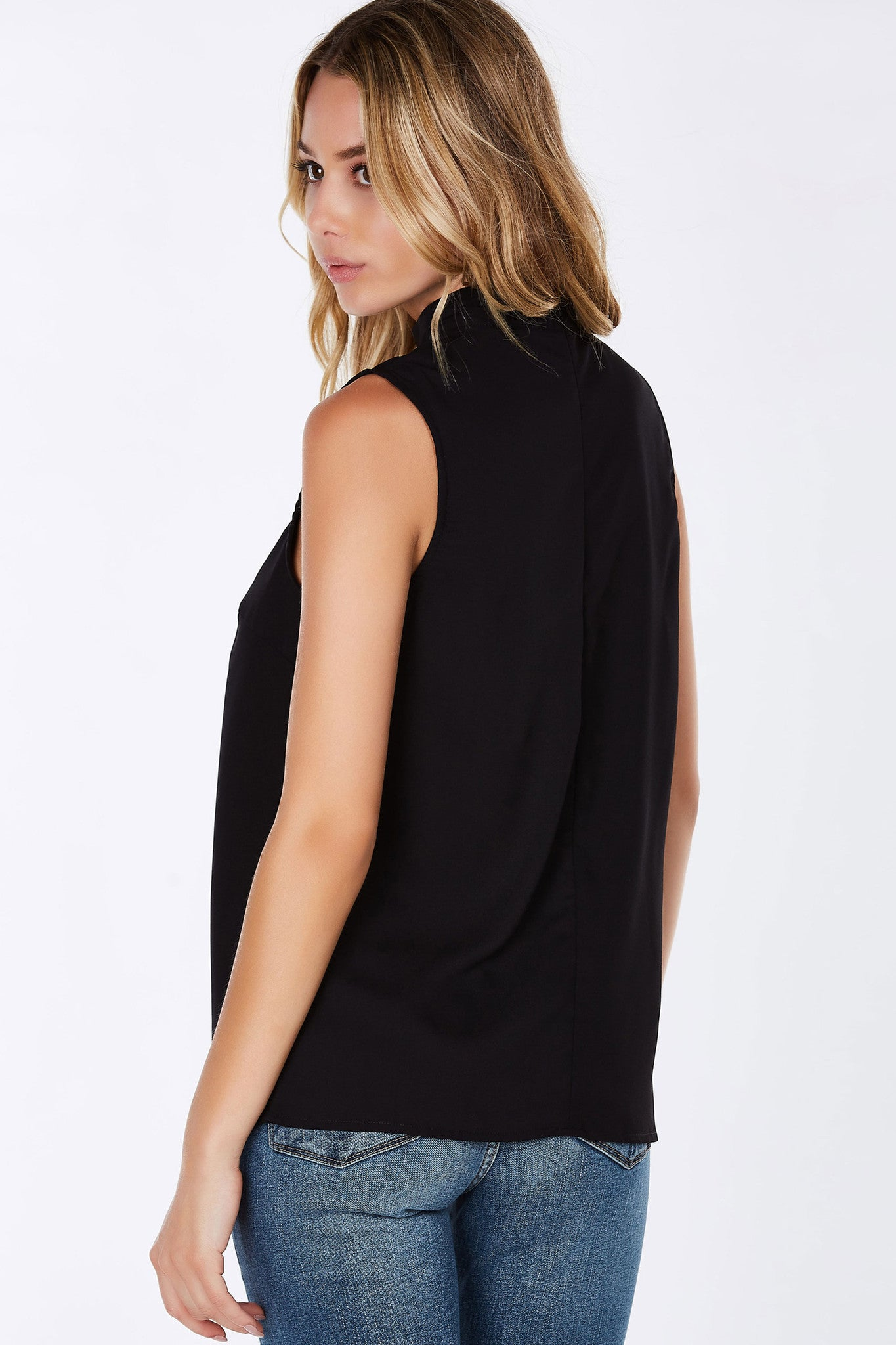 Get the city girl look with this chic sleeveless top. Mock neck with a plunging cut out in front, you'll definitely hold everyone's attention in it! Hidden zipper in the back for a seamless finish. Pair with trousers for a business look!