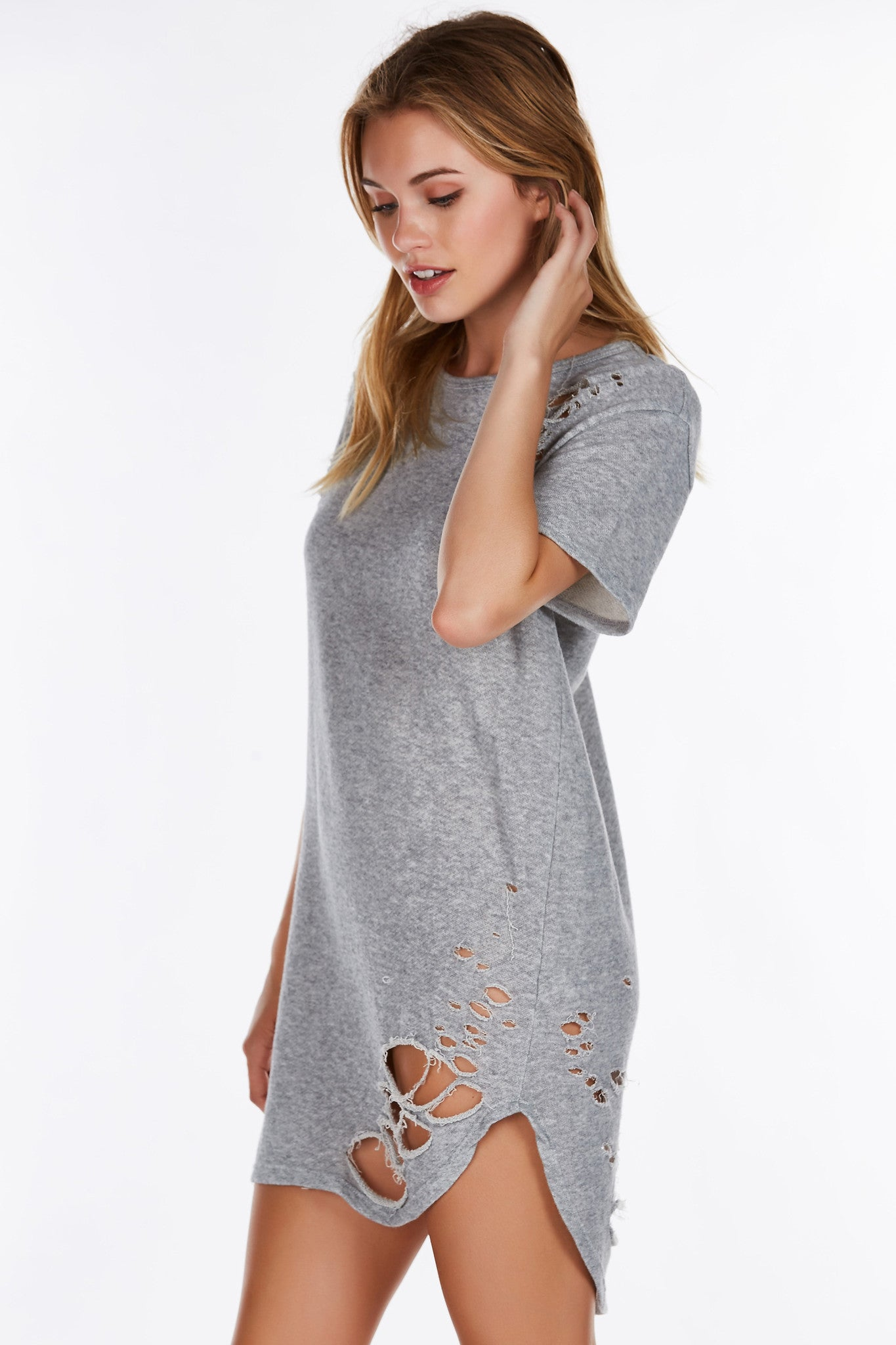 If you're into the street-style look, you'll love this dope distressed tunic. Neckline mirrors the rounded hi-low hem with casual short sleeves. Amazing tears throughout for a vintage, worn out vibe. Wear it as a dress or a long line tee depending on your look for the day!