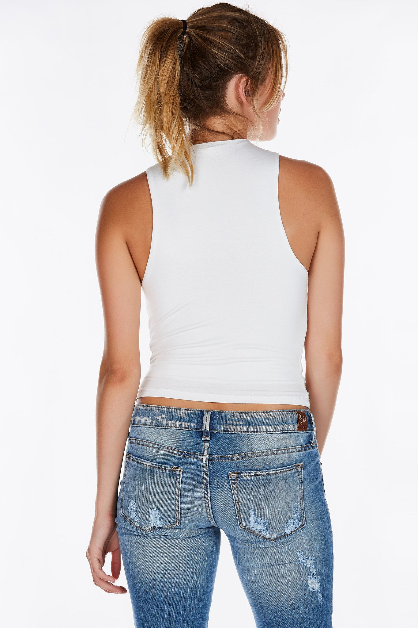 A staple for everyone's wardrobe. This fully lined high neck top is perfect all year round. Slightly cropped makes it easy to style with all kinds of bottoms. Soft stretchy material, you'll find yourself coming back for all colors!