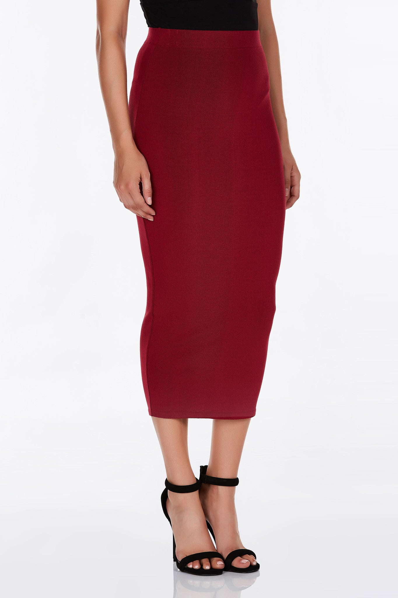 Body hugging maxi skirt offers a Kardashian-esque sexy appeal. High waisted with a hem that cuts right at the lower shin--perfect for showcasing some strappy, lace-up shoes.