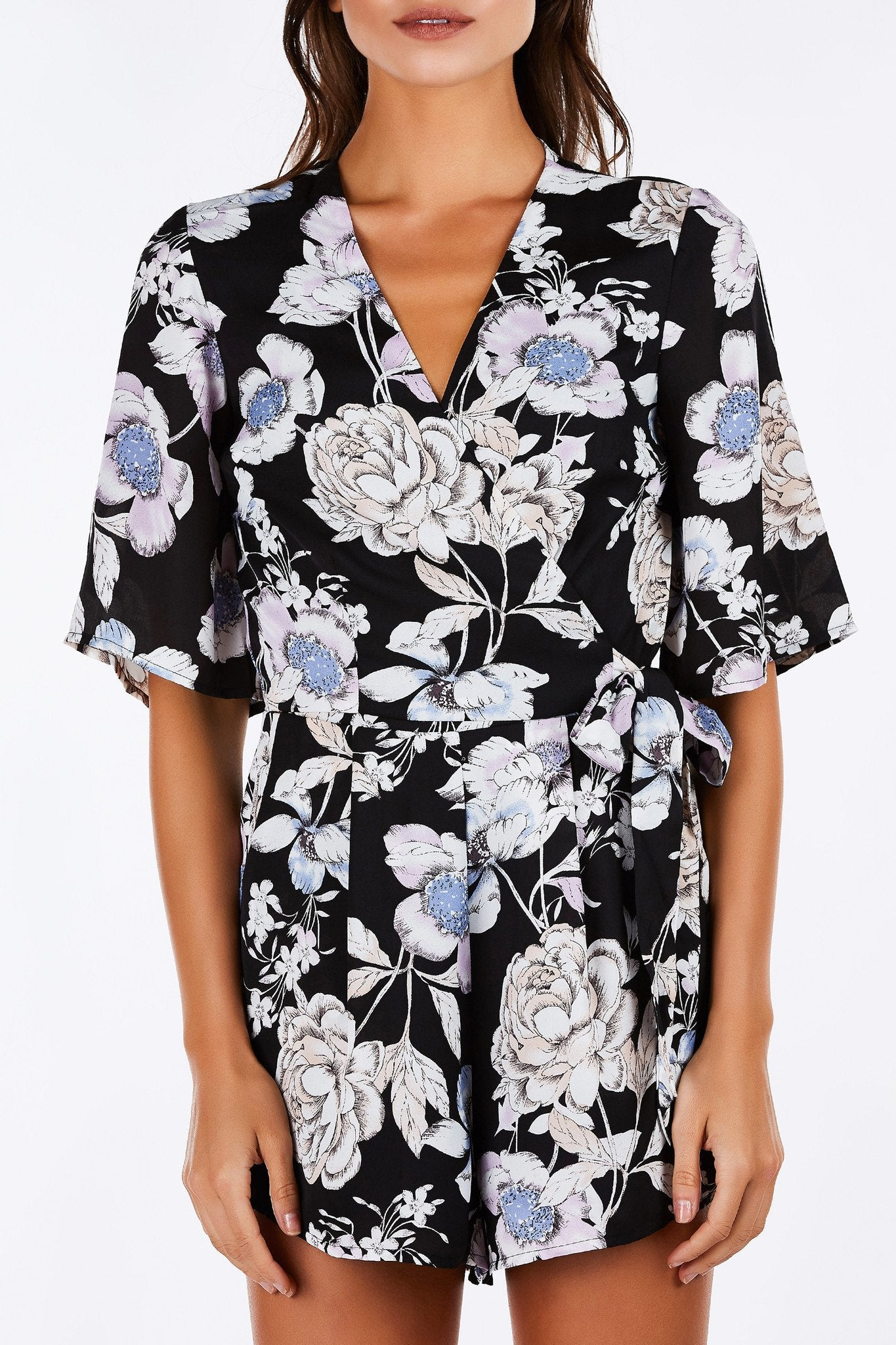 This romper will take everyone's breath away with it's intense, beautiful floral prints throughout. Has a chic cut with a flattering wrap detail in front. Cropped sleeves with functional pockets to keep your belongings safe. Don't fight the temptation to add this romper to your collection!