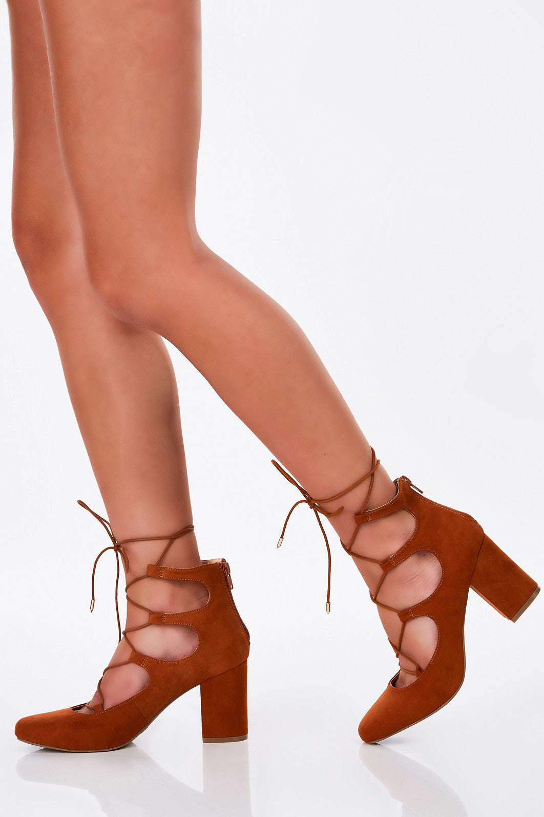 The perfect go-to pair of heels for all the baby dolls out there! Gorgeous lace up detailing with a lovely suede exterior. Block heels for comfortable walking. Rounded toe for a soft, feminine finish with easy zip closure. Perfect to pair with A-line dresses!