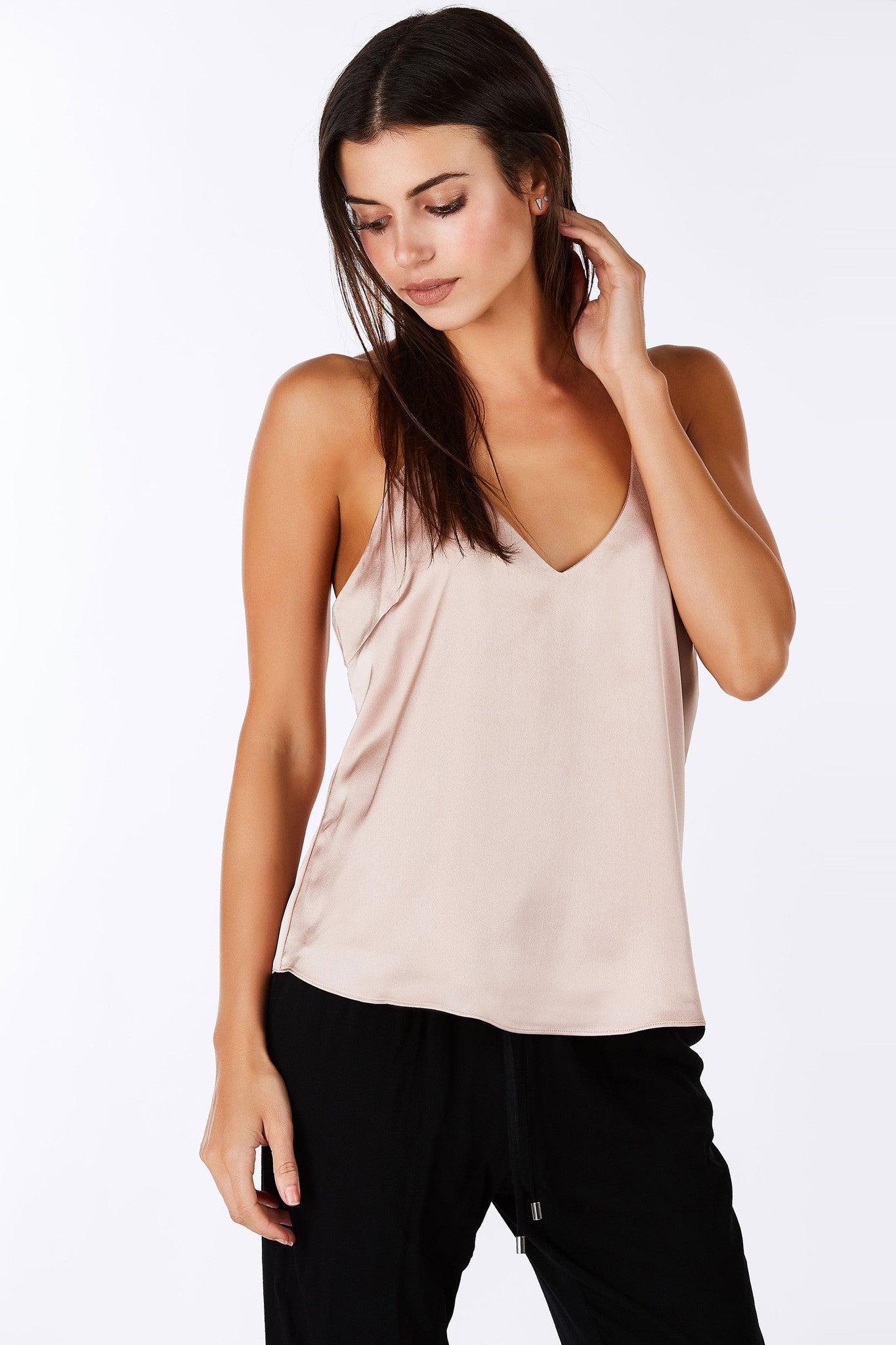 This gourgeous tank is the perfect top for a chic daytime city look or a sultry evening look. Irresistibly smooth exterior with a classic V-neckline. Racerback style multi straps in the stunning open back. Soft rounded hem, great to style with skinny bottoms and pumps.