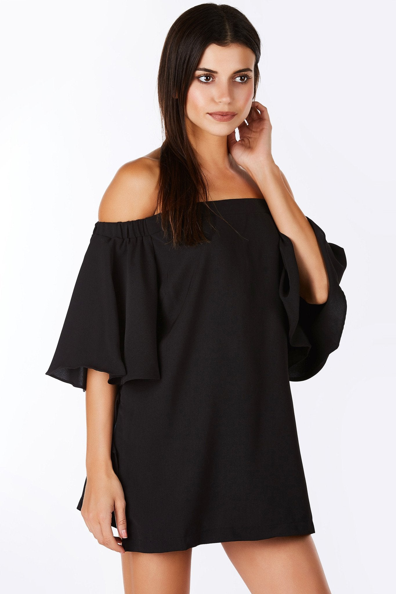 A classy off shoulder blouse with chic, flared short sleeves. Gorgeous material, feels amazing against the skin. Features slits on each side for a trendy touch. Single hidden zipper down the back for closure.