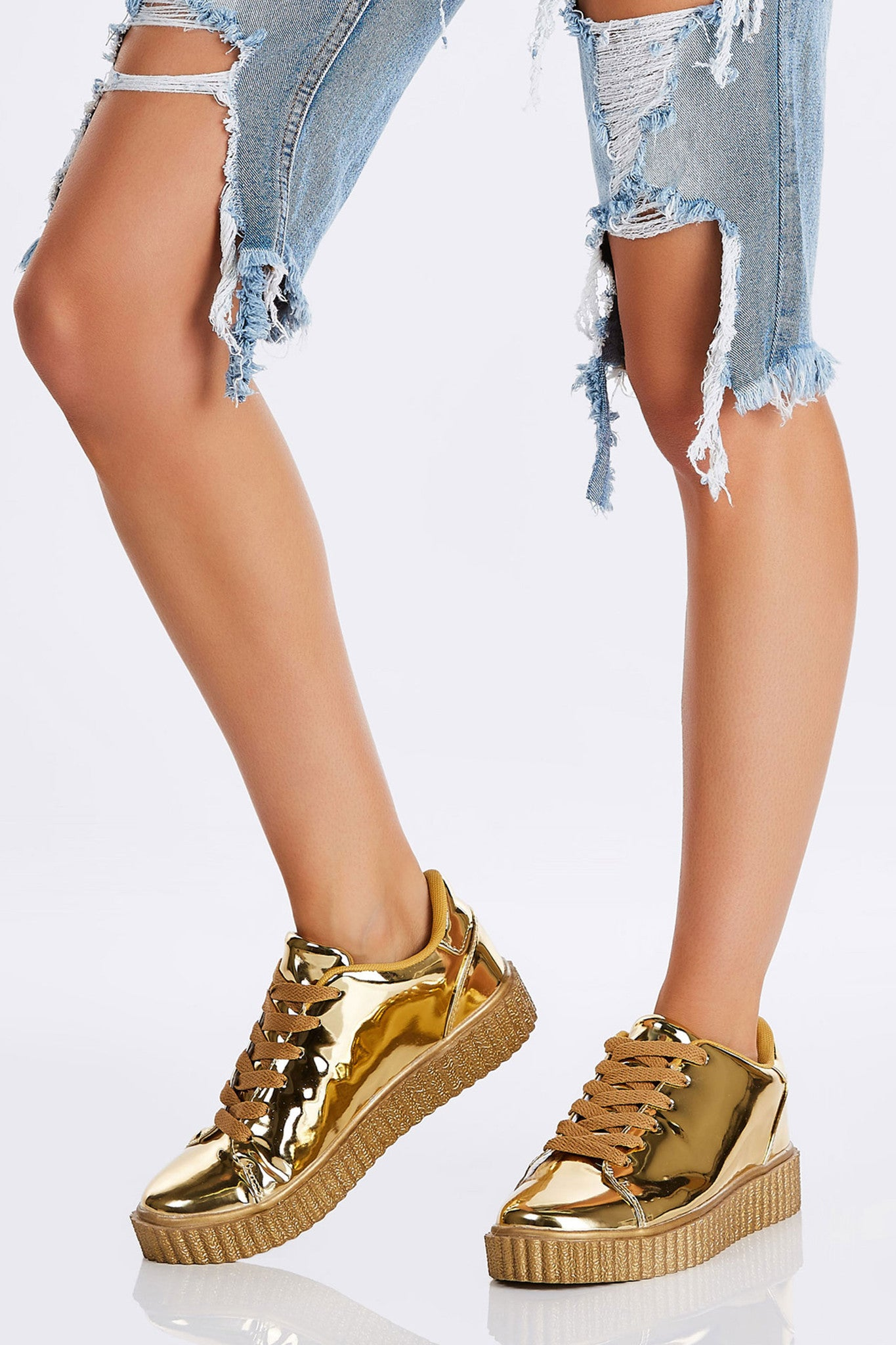 "A dope pair of kicks with a ""touch"" of bling. Comfortable platforms for the trendy creeper style finish. An effortless way to add some height and funk to your look."