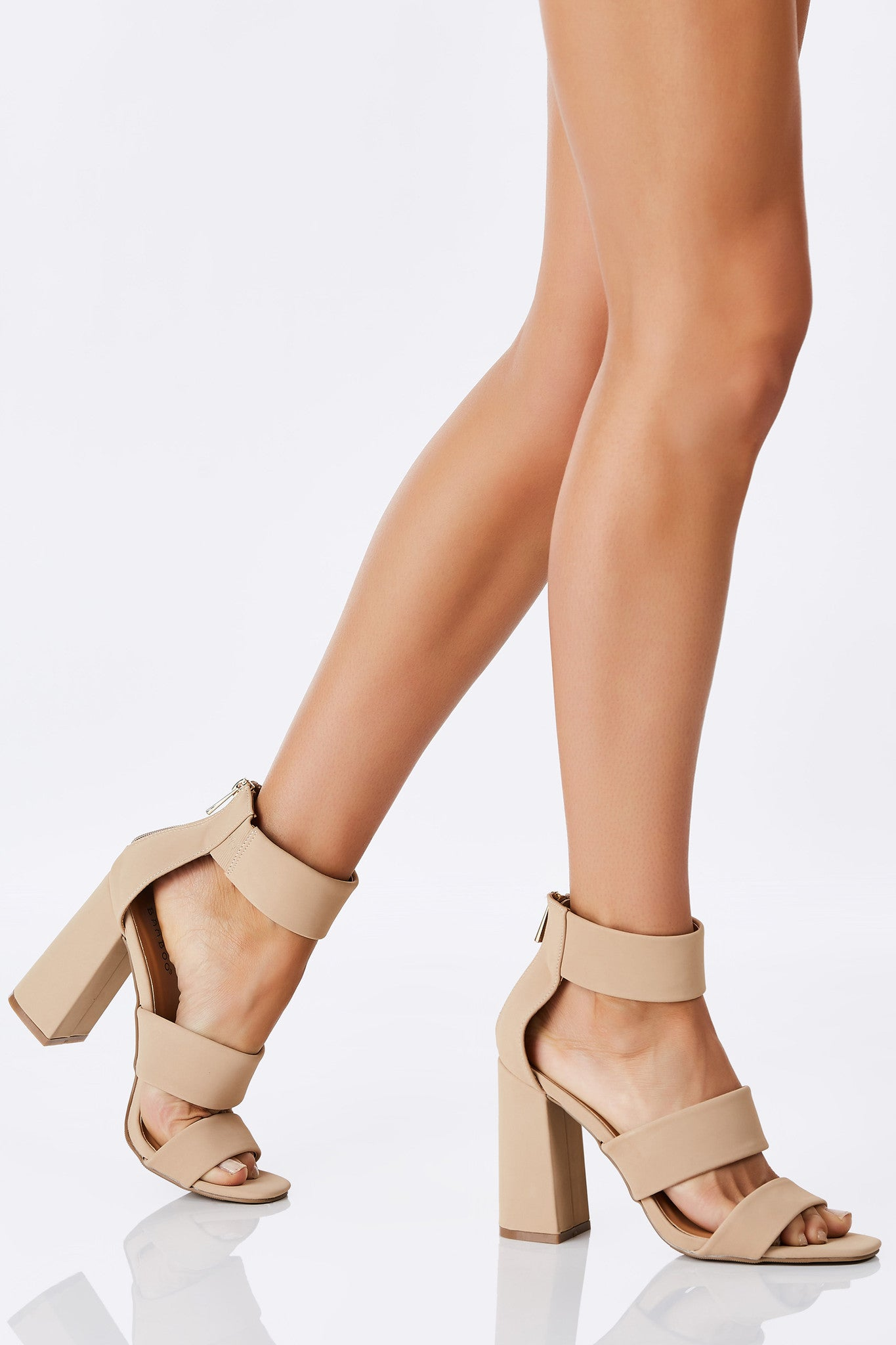 Every shoe-lovers dream pair of heeled sandals. Chic three strap design with a trendy chunky heel. Easy single zip closure. Perfect to dress up any outfit in comfort.