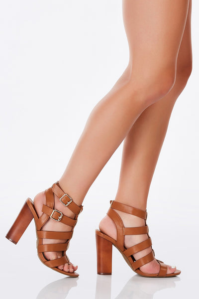A dope pair of sandals with an awesome block heel. Trendy caged detailing with buckles for adjustable fit. Makes a perfect go-to Summer shoes for just about any ocassion!
