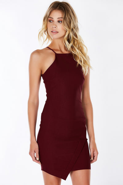 Sensual, classy, chic.. the list goes on! This beautiful mini dress features a high neckline with delicate spaghetti straps. Envelope detail in front and hidden zipper in back for closure. Perfect for office parties!