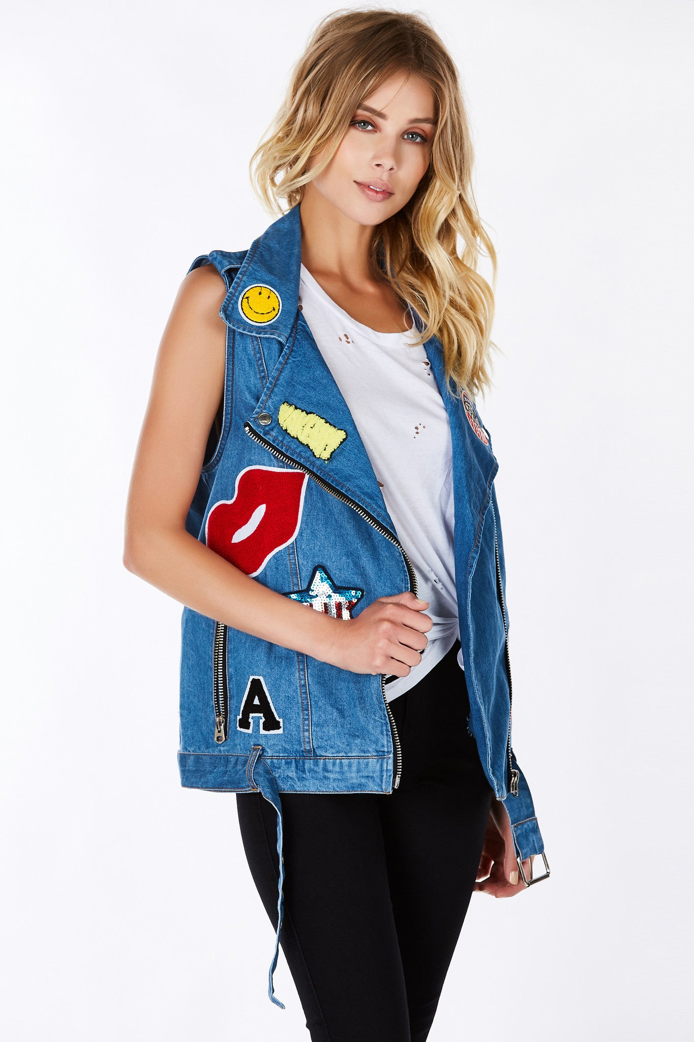 An incredible denim vest with awesome patches throughout the front for personality and style! Sturdy material to last you a lifetime. Classic moto style cut and design. The perfect additional to any basic outfit.