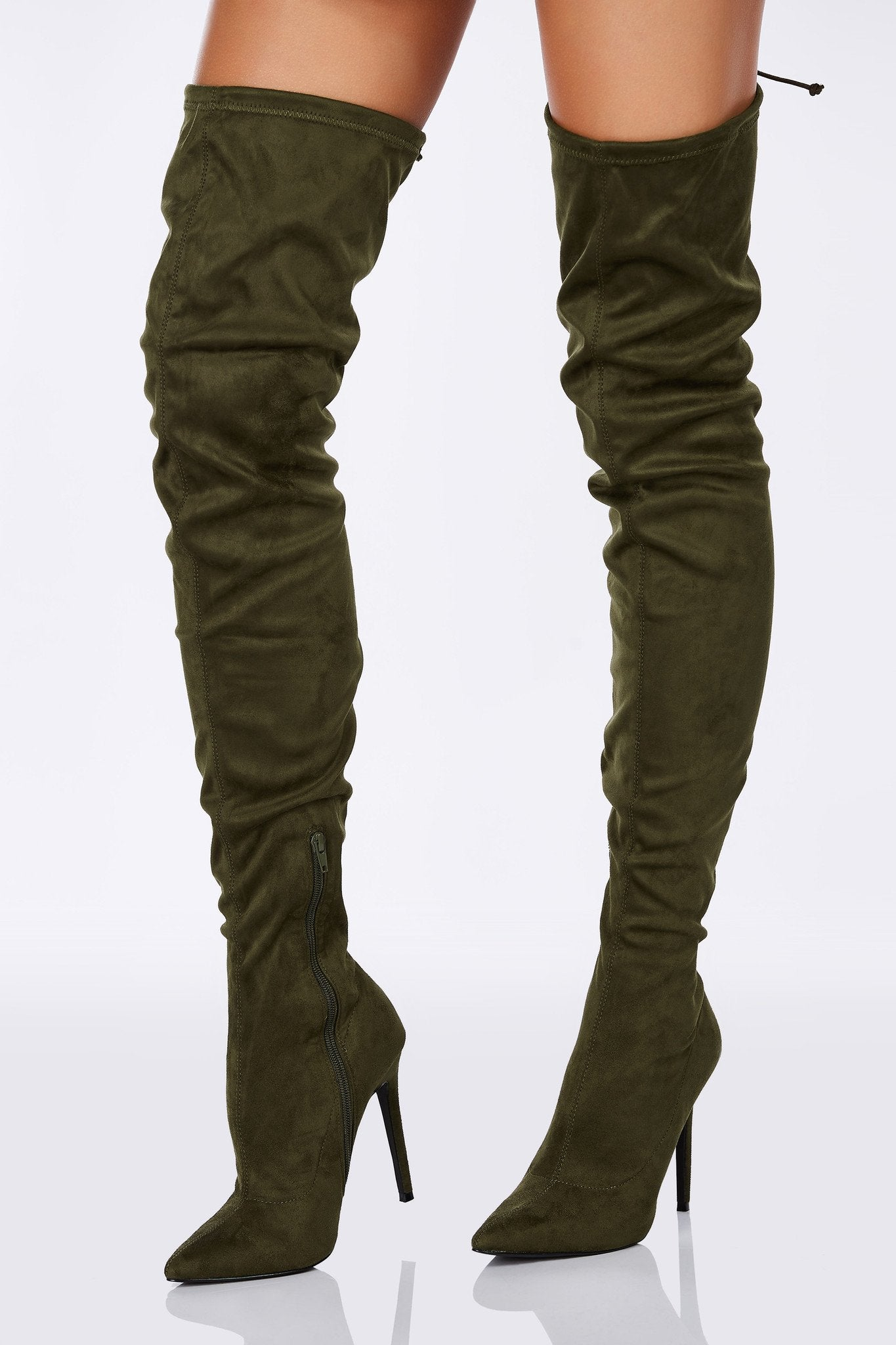 An incredibly sexy pair of thigh high boots with a sultry stiletto heel. Chic suede exterior with a sassy slim fit. Ties up at the end for fit with a side zip closure for easy access. Pair with short shorts or mini dresses!