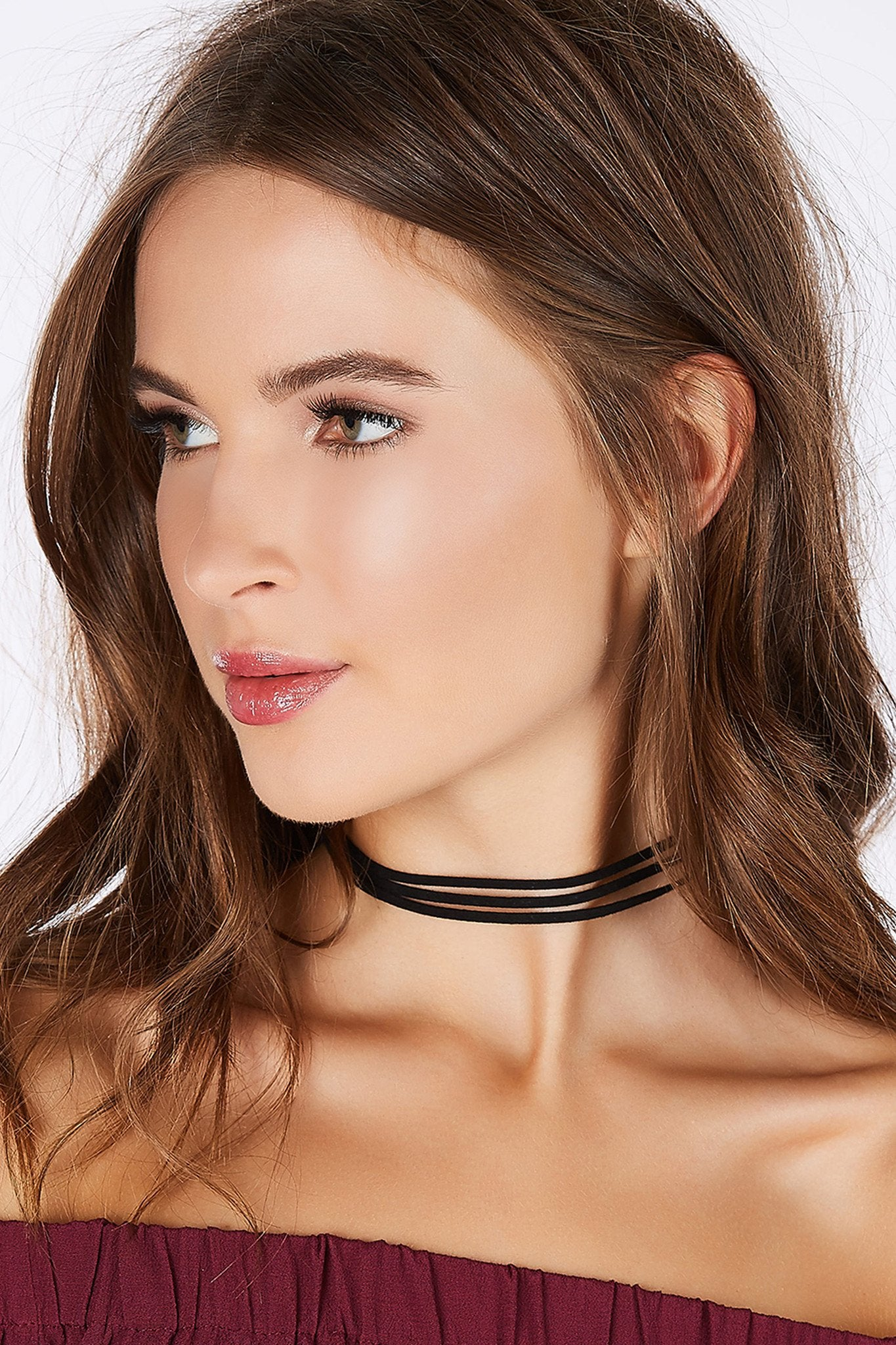 A trendy three strap choker perfect for your daily outfits or a night time look! Chic suede cord with lobster clasp for fit and closure.