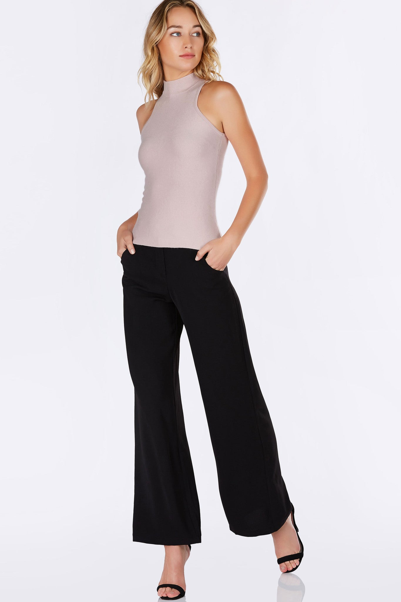 A great transitional piece to have in your wardrobe. Flattering mock neck with a comfortable slim fit. Cozy blend of materials feel incredibly soft against the skin. Exposed zipper in back for closure and added detail. Pair with skinny jeans and pumps for a chic outfit.