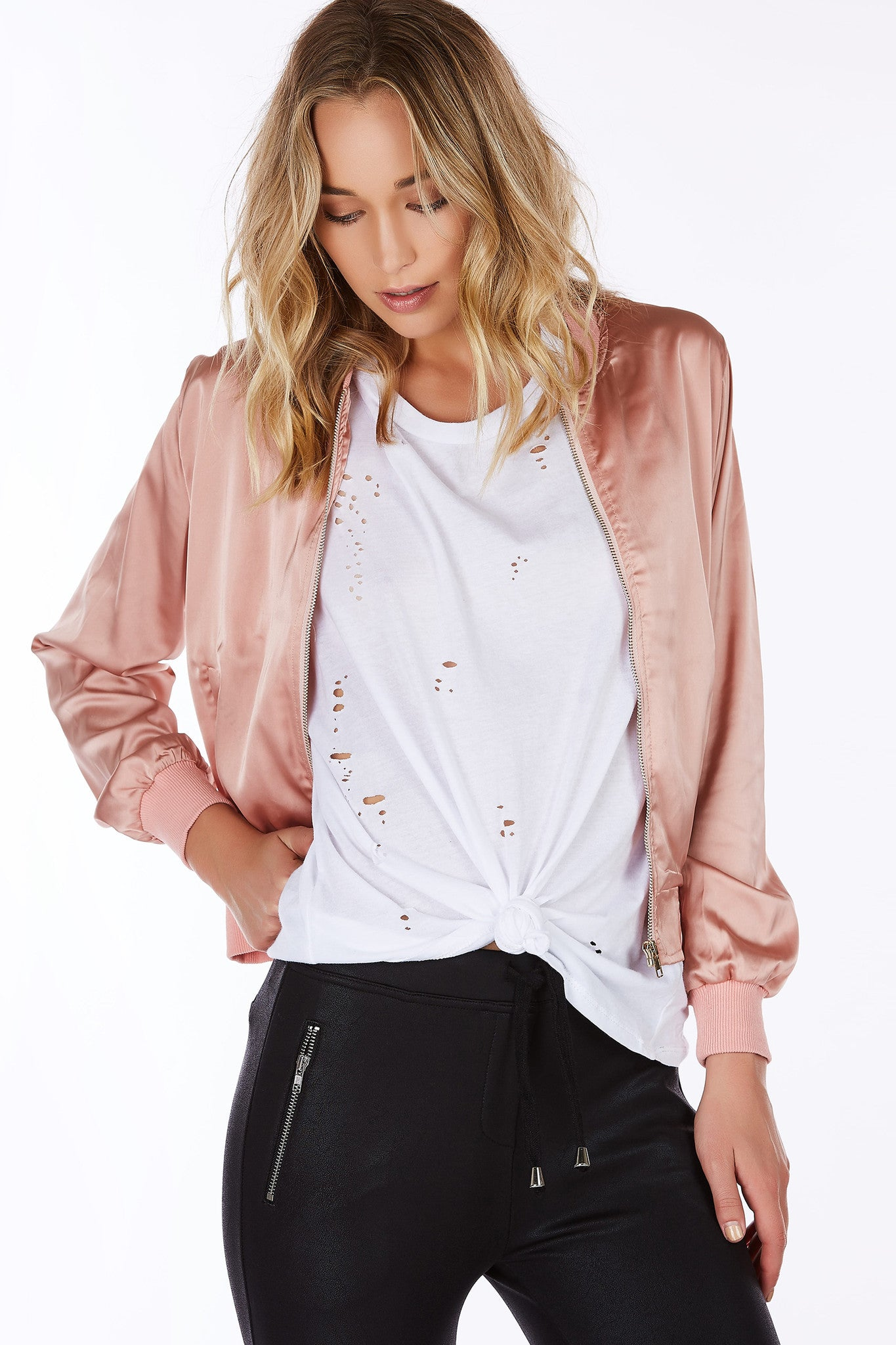 The perfect jacket for Summer nights. Classic bomber design with a chic, silky finish. Two functional pockets with single front zip closure. Great to throw on over a midi dress for a night time look.