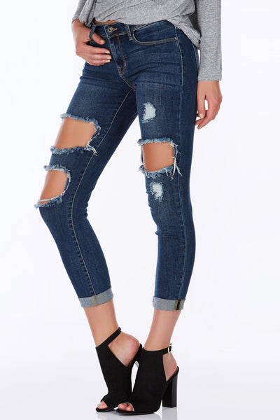 A staple piece for everyone's wardrobe. Classic pair of skinny jeans with a flattering deep wash. Trendy distressing in front brings a casual-chic vibe. Easy to dress up or down based on your mood and destination.