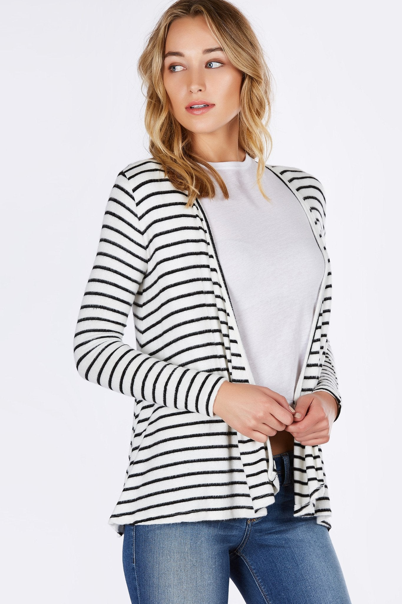 Grab this amazing transitional piece while it lasts! Awesome stripe patterns with incredibly soft exterior. Slim fit long sleeves with a comfortable relaxed fit body. Great to throw on over a bodysuit and shorts!