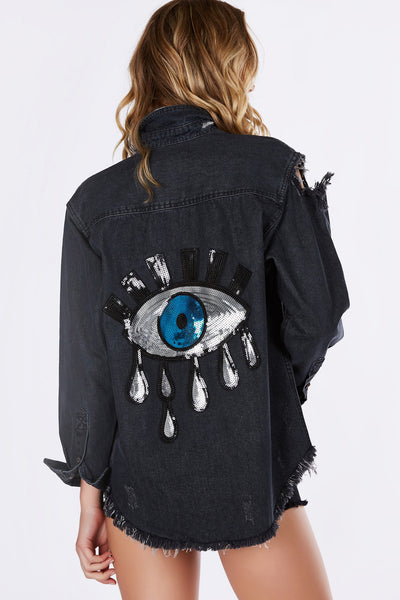 A dope statement piece, great to wear along or style as a jacket! Trendy distressing throughout with an incredible back. Sequin patch brings personality and glam to your look. An easy way to build a street-style outfit!