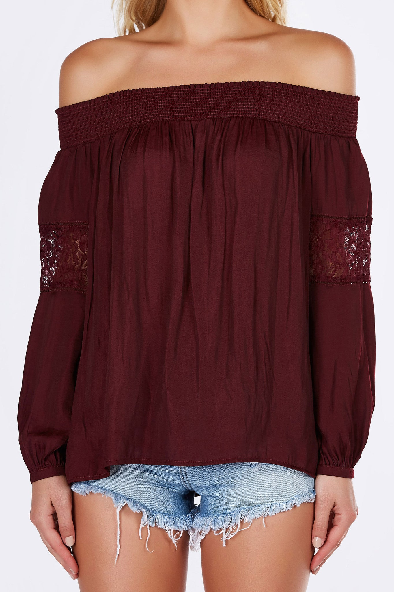 Silky smooth material, this off shoulder chiffon blouse is seductive yet elegant at the same time. Gorgeous contrast lace panels on each sleeves for a sultry twist. Flowy, feminine fit- great to pair with skinnies and ankle strap pumps.