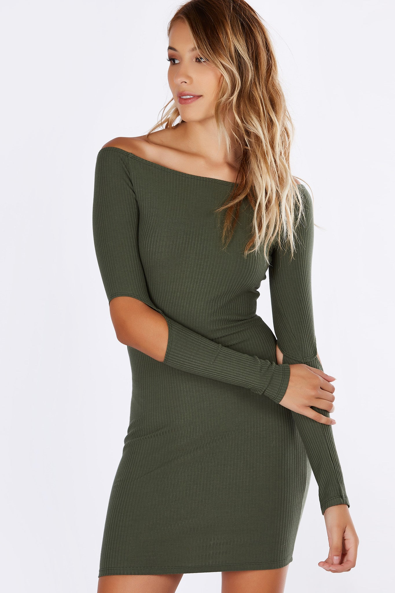 A slim fit, sexy mini dress just in time for the upcoming season! Chic neckline with fitted long sleeves. Features slits on each elbow for an unexpected twist. Ribbed material provides amazing stretch for all night of dancing!