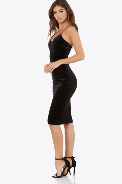 Be the center of attention without even trying in this gorgeous midi dress! So simple yet incredibly chic. Velvet exterior brings a luxurious vibe to your look. Slim fit with stretch for comfort. Pair with your favorite heels!