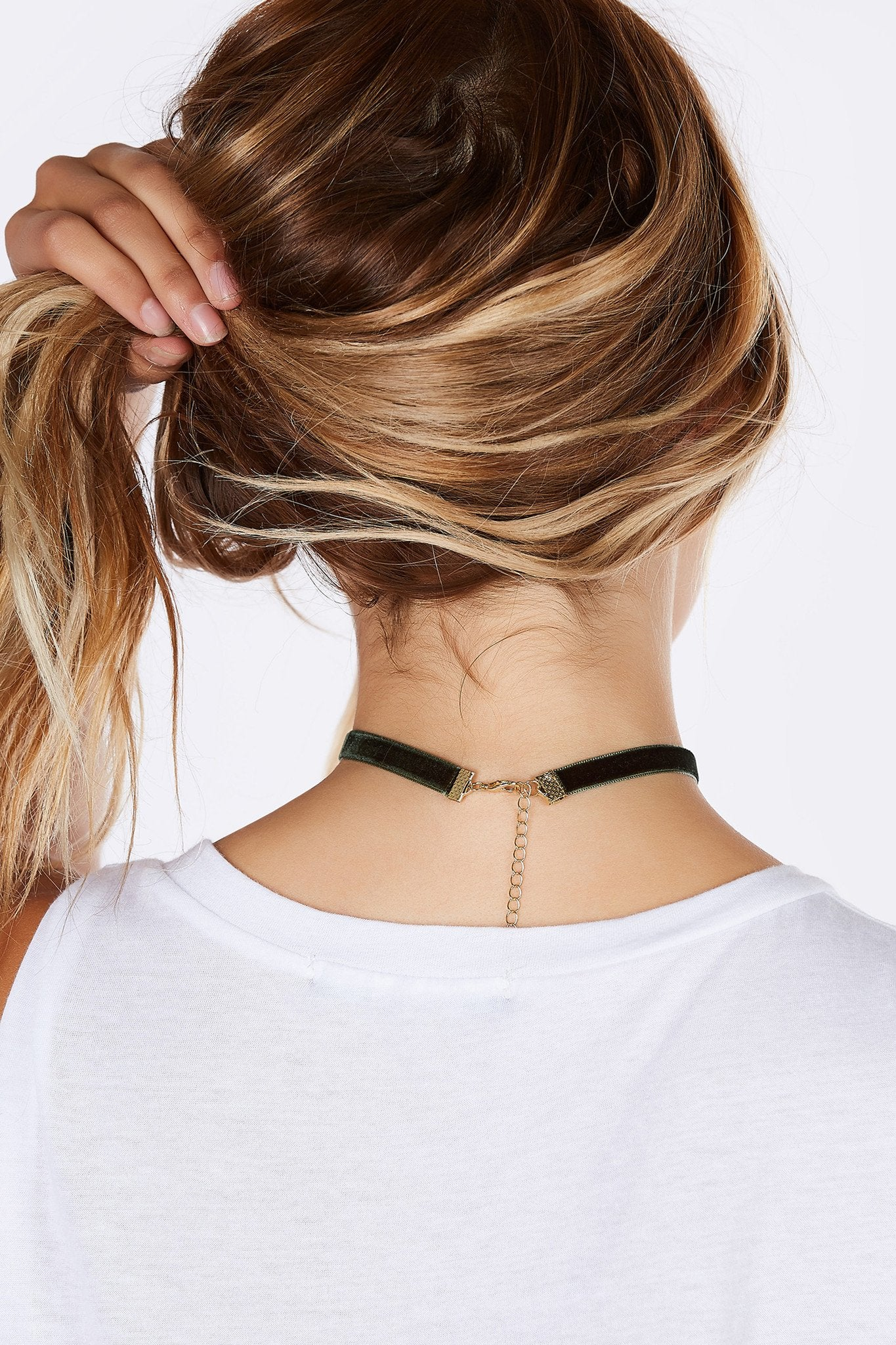 A chic choker with a lovely velvet finish. A trendy accessory that will go with just about any outfit! Simple strap detailing with lobster clasp for fit and closure.