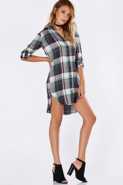 Everyone needs to own at least one flannel in their wardrobe. This adorable button down is perfect for building transitional oufits! Soft lightweight material with rounded hi-low hem. Wear it as a long line top or as a dress with sneakers!