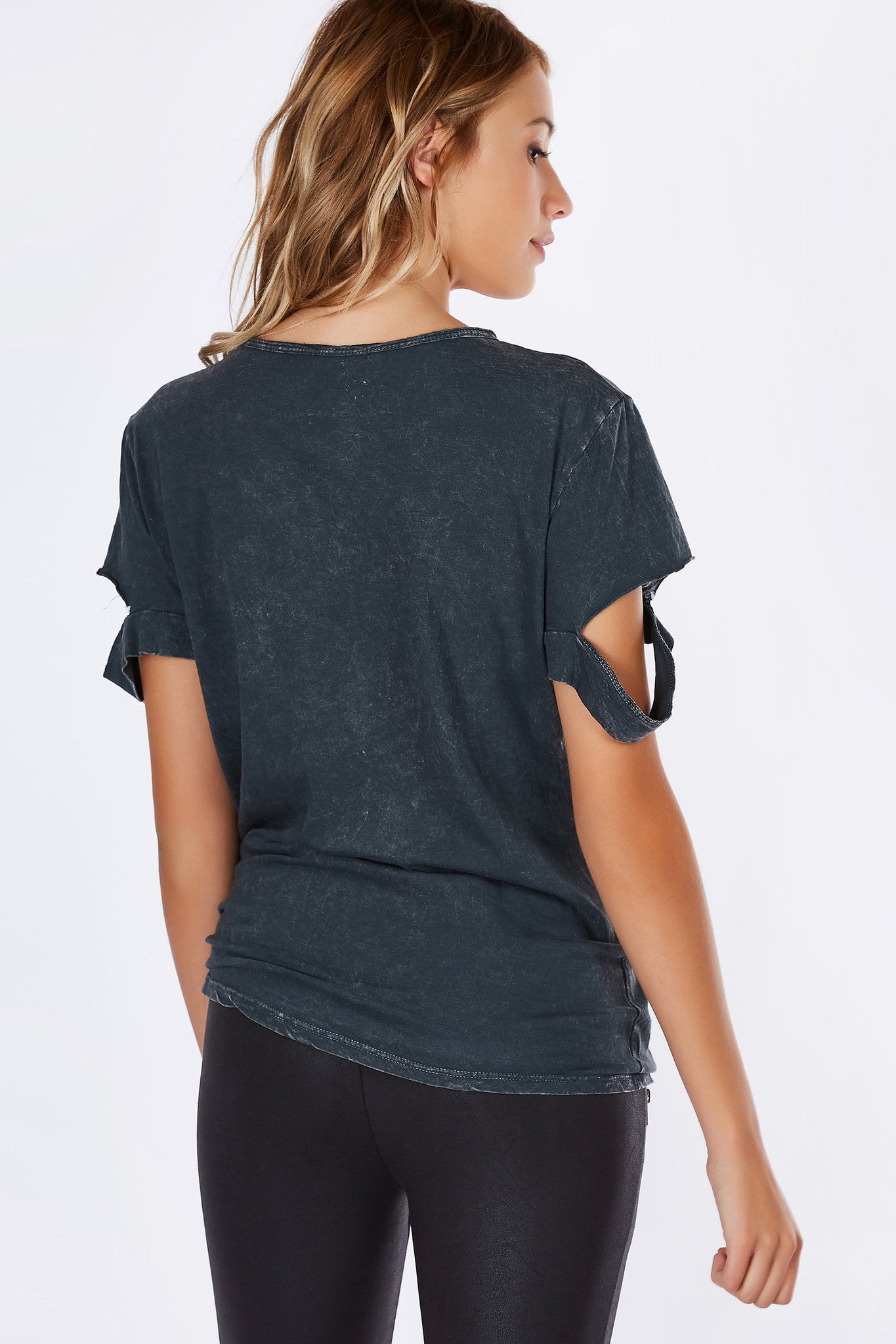 A basic pocket tee with a vintage-esque washed out finish. Distressed slits on sleeves for a trendy twist. Soft lightweight material makes for a perfect every day top. Pair with skinny jeans and sneakers for a casual outfit.