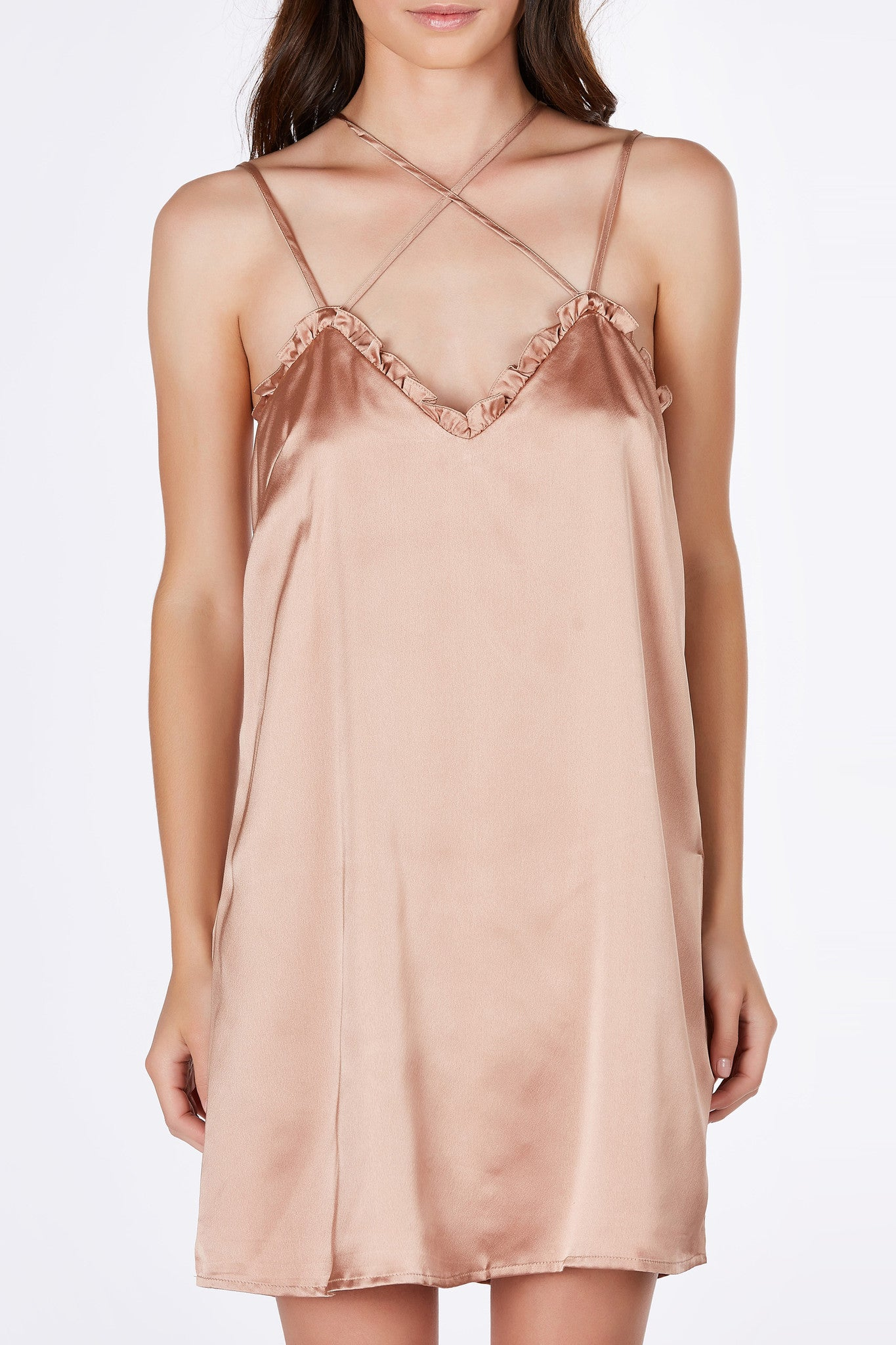 A gorgeous slip dress with a chic silky finish. Multi strap detailing that criss crosses in both front and back. Ruffled neckline for a feminine touch. Fully lined with a straight boxy cut. Layer over a clean white tee for a stylish 90's inspired outfit!